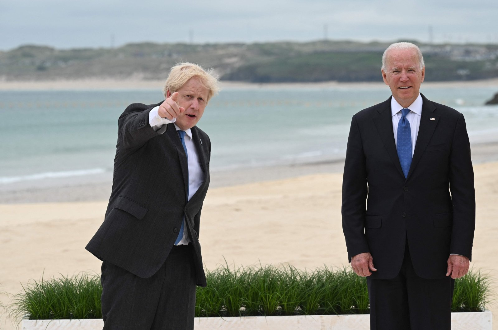 Britain's Prime Minister Boris Johnson (L) US President Joe Biden (R) pose for an official photograph at the start of the G7 summit in Carbis Bay, Cornwall, south-west England on June 11, 2021. (Photo by Leon Neal / POOL / AFP)