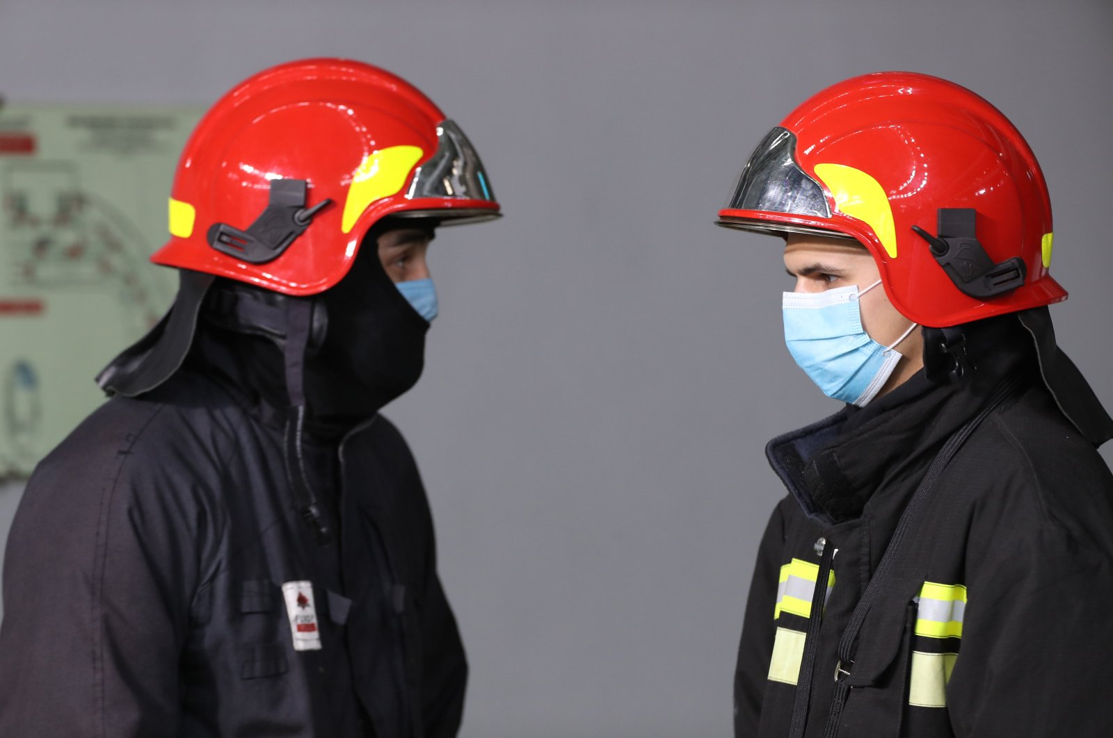 Firefighters stand in protective equipment, in Moscow, Russia, Oct. 11, 2020. (Reuters Photo)