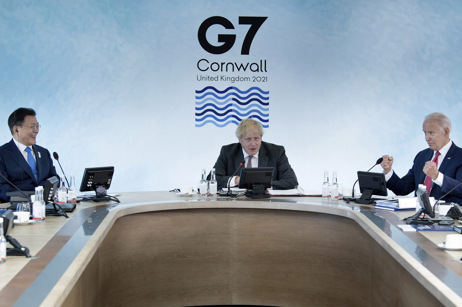 South Korea's President Moon Jae-in (L), Britain's Prime Minister Boris Johnson (C) and U.S. President Joe Biden work during a session at the G-7 summit in Carbis Bay, Cornwall, England, June 12, 2021. (AP Photo)