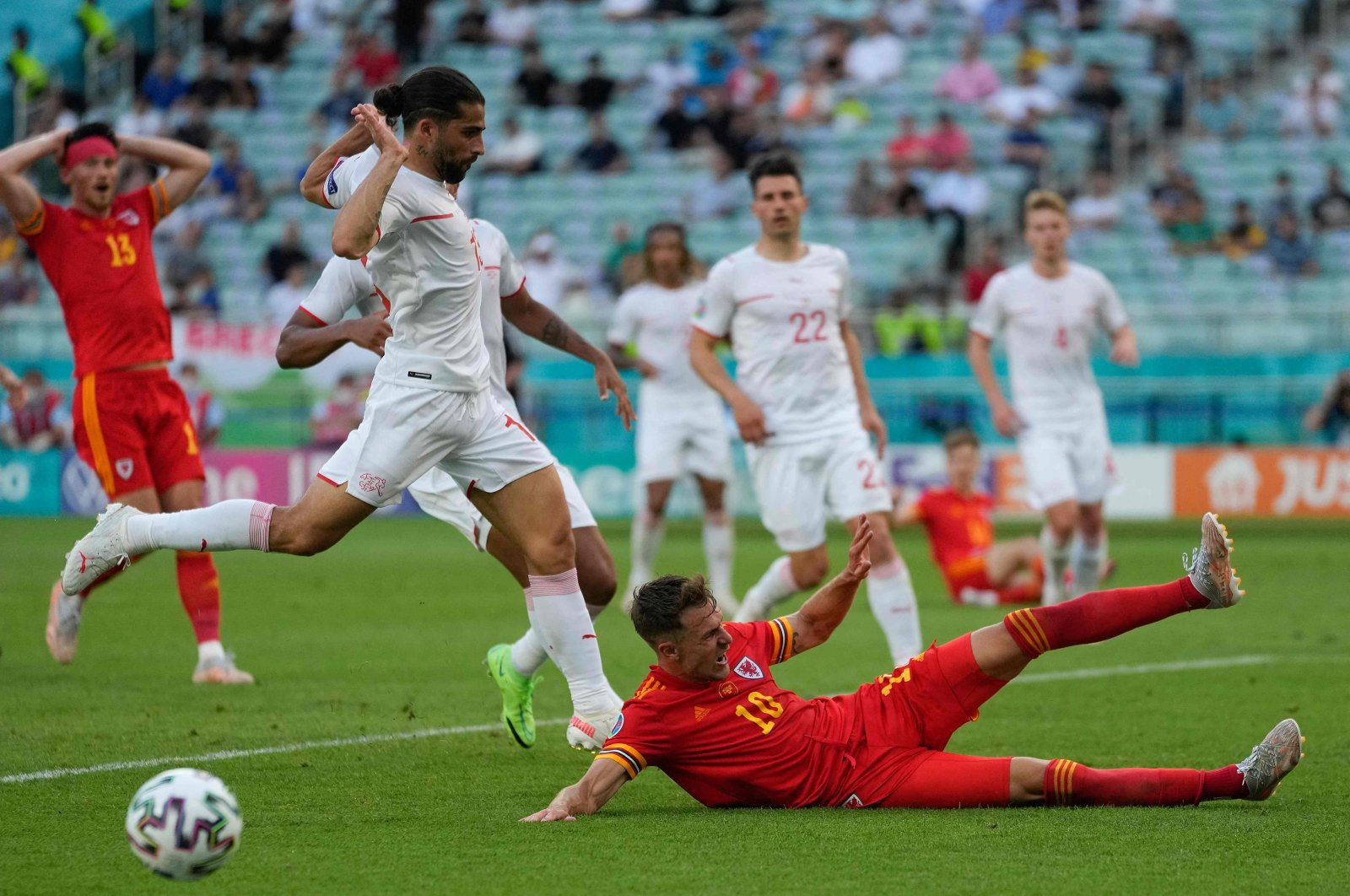 Switzerland's defender Ricardo Rodriguez (2nd L) tries to prevent a foul call after Wales' midfielder Aaron Ramsey (#10) lands on the ground during the UEFA EURO 2020 Group A football match between Wales and Switzerland at Olympic Stadium in Baku, Azerbaijan, June 12, 2021. (AFP Photo)