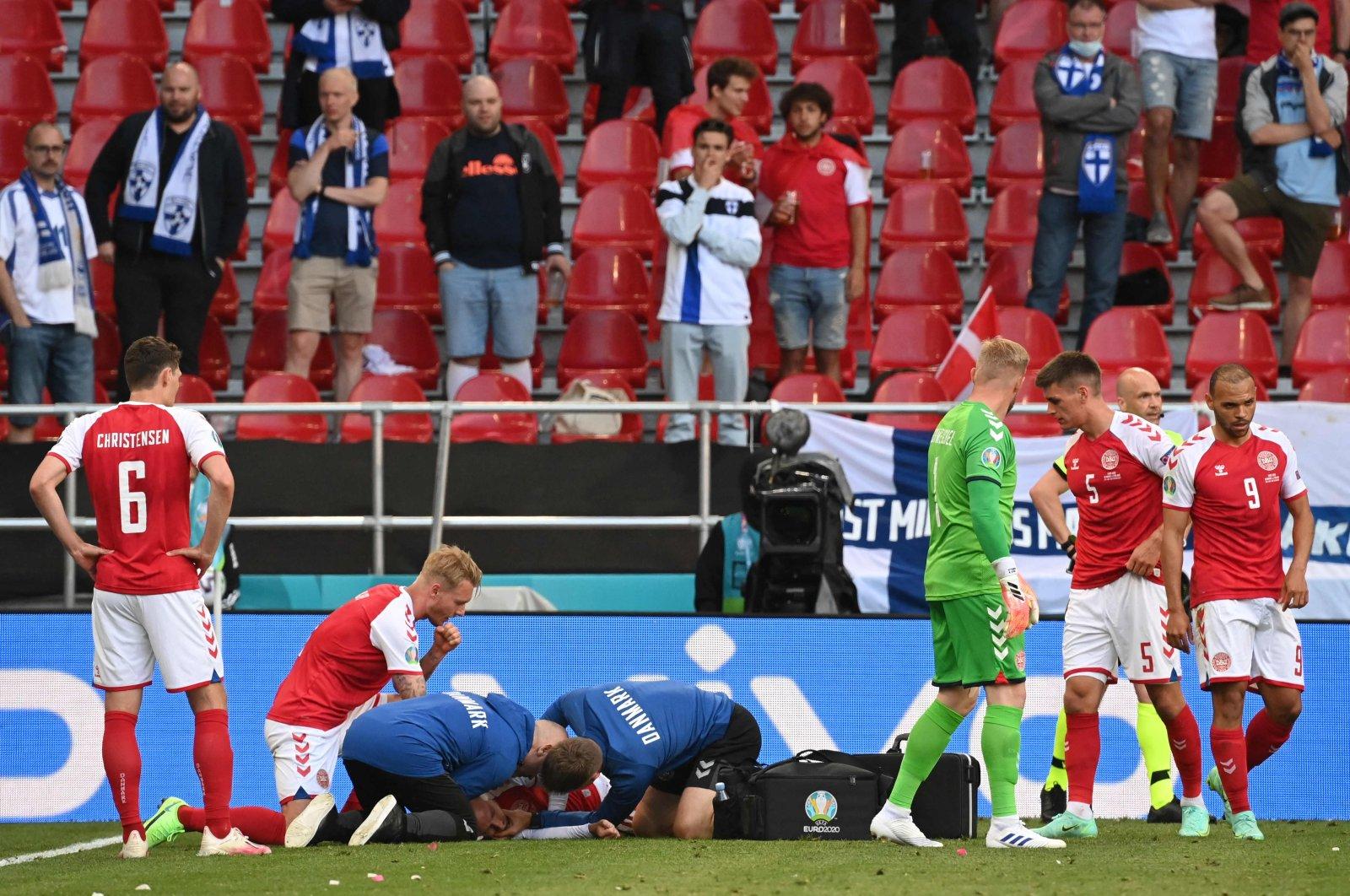 Medics attend to Denmark's midfielder Christian Eriksen after he collapsed during the UEFA EURO 2020 Group B football match between Denmark and Finland at Parken Stadium in Copenhagen, Denmark, June 12, 2021. (AFP Photo)
