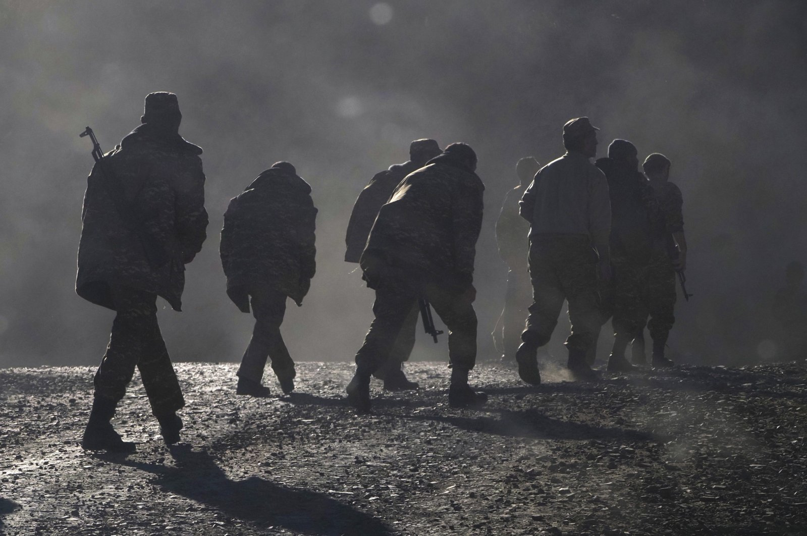 Armenian soldiers walk along the road near the border between Armenia and Nagorno-Karabakh, Azerbaijan, Nov. 8, 2020. (AP Photo)