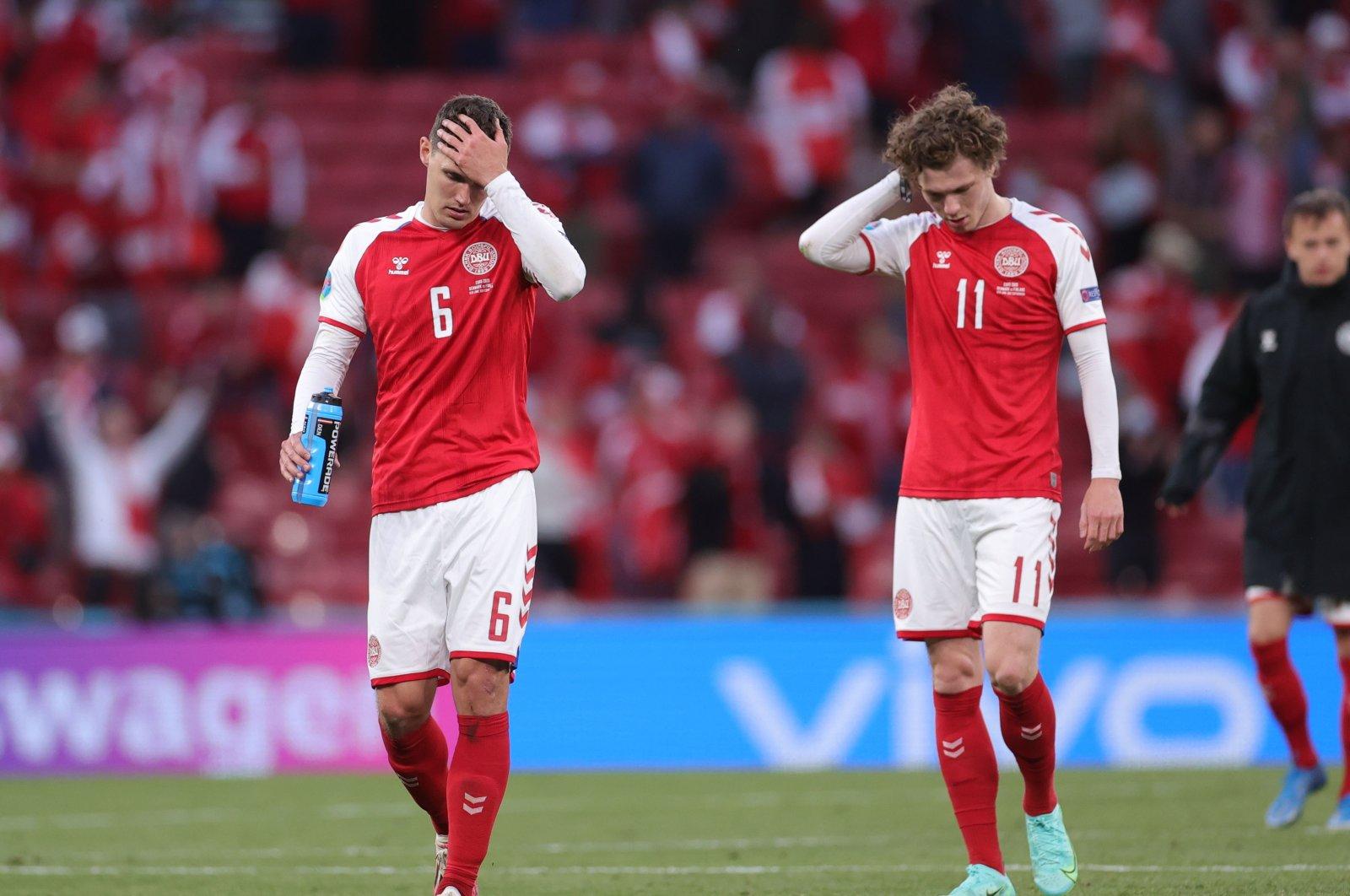 Denmark's Andreas Christensen (L) and Andreas Skov Olsen look dejected after the Euro 2020 match against Finland at Parken Stadium in Copenhagen, Denmark, June 12, 2021. (Reuters Photo)