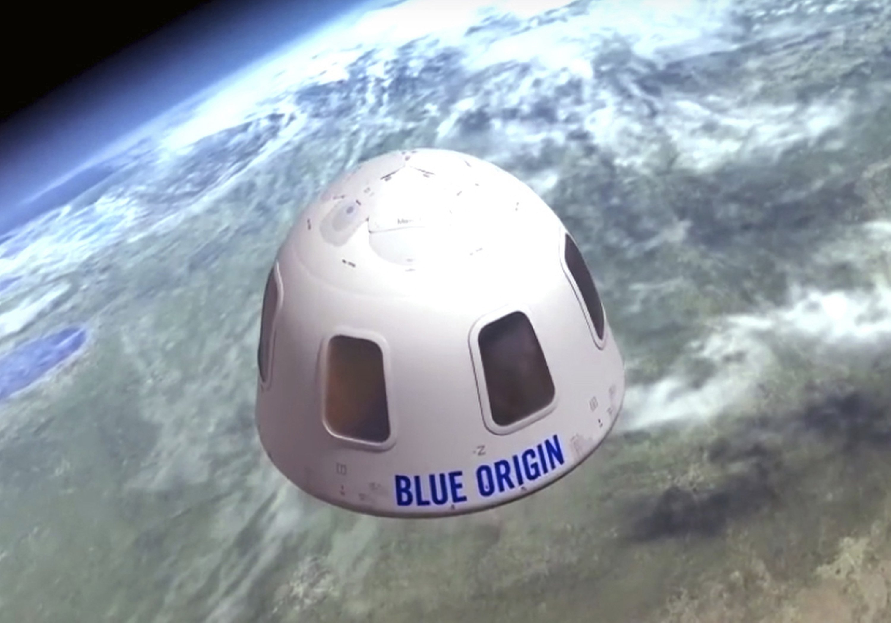 The capsule Blue Origin aims to take tourists into space with floats over Earth, in this undated file illustration provided by Blue Origin. (Blue Origin via AP)