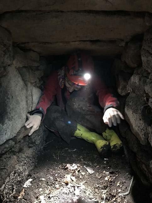 Cultural heritageconservation specialist and historian Arzu Ulaş crawls through an underground tunnel in Istanbul, Turkey, June 13, 2021. (DHA Photo)