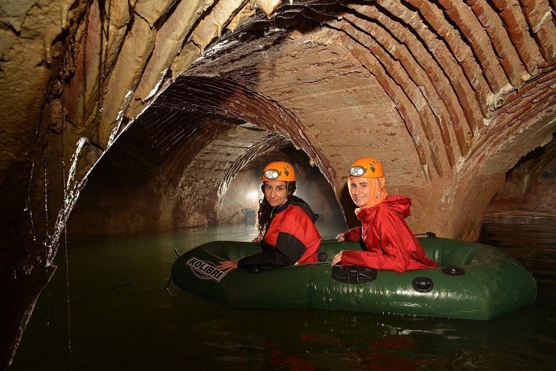 Cultural heritageconservation specialist and historian Arzu Ulaş traverses the underground water channels on a boat with a colleague in Istanbul, Turkey, June 13, 2021. (DHA Photo)