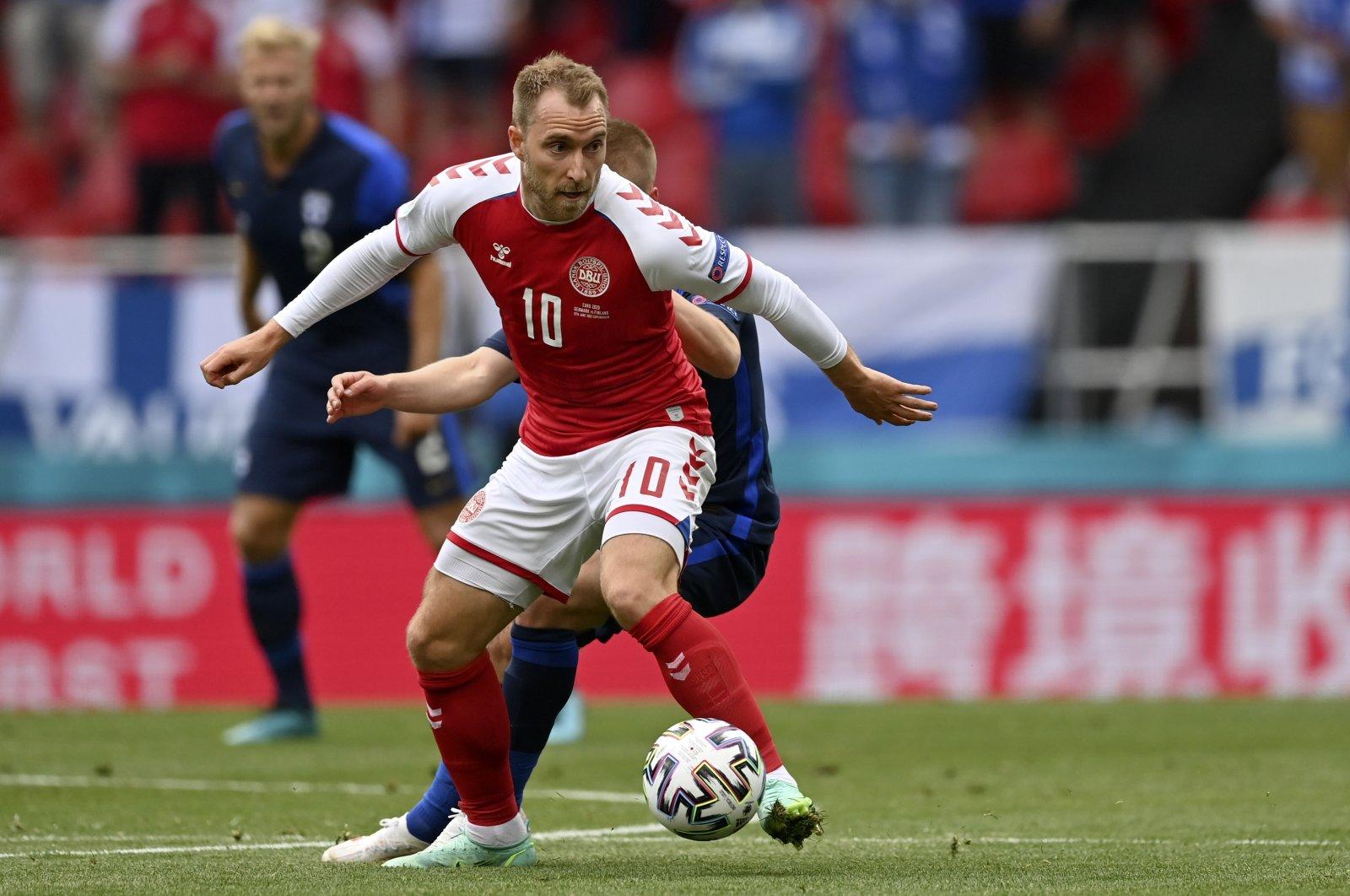 Denmark's Christian Eriksen controls the ball during a Euro 2020 match against Finland at Parken Stadium in Copenhagen, Denmark, June 12, 2021. (AP Photo)