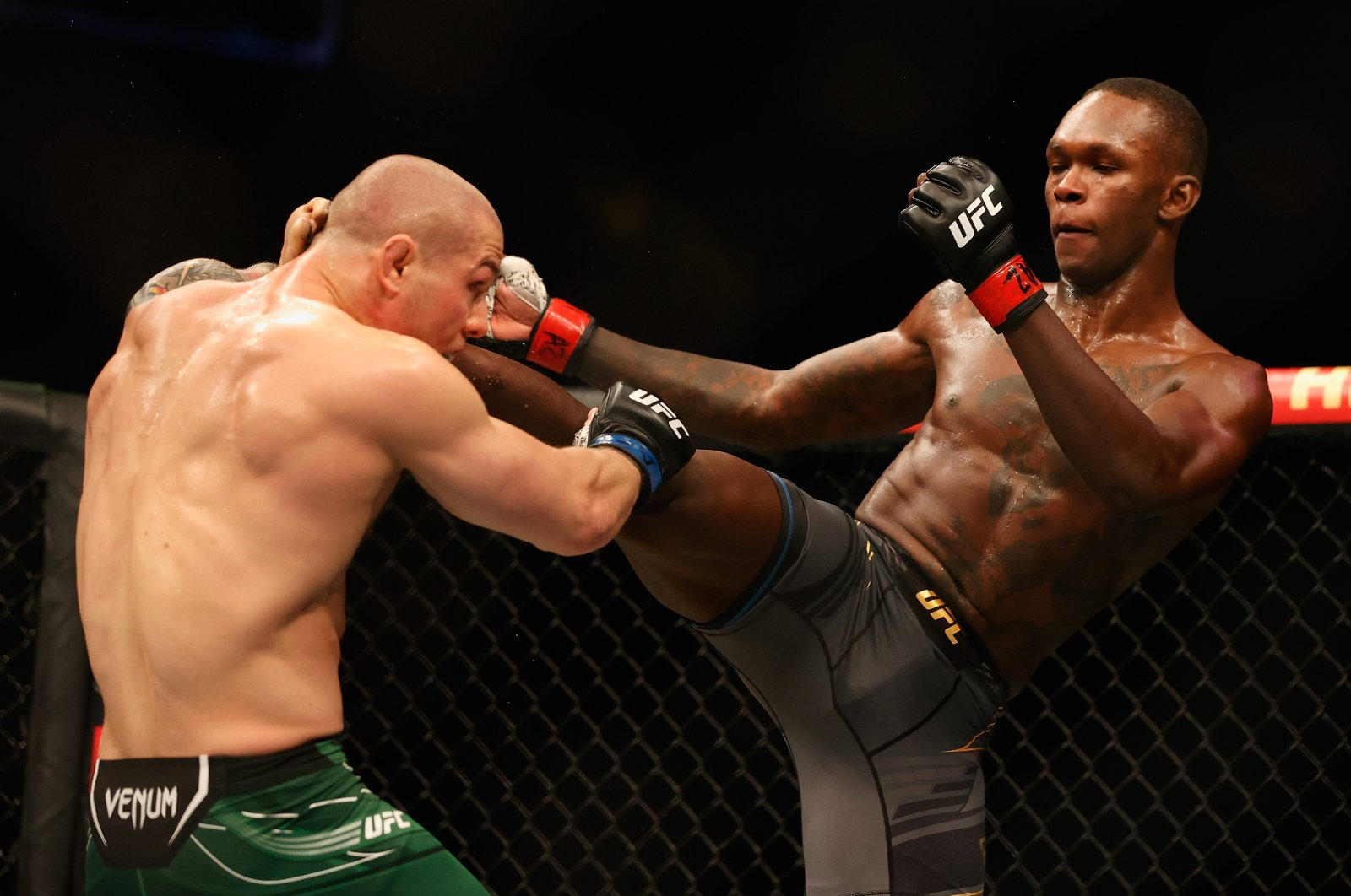 Israel Adesanya fights Marvin Vettori during their UFC 263 middleweight championship match at Gila River Arena, Glendale, Arizona, U.S., June 12, 2021.
