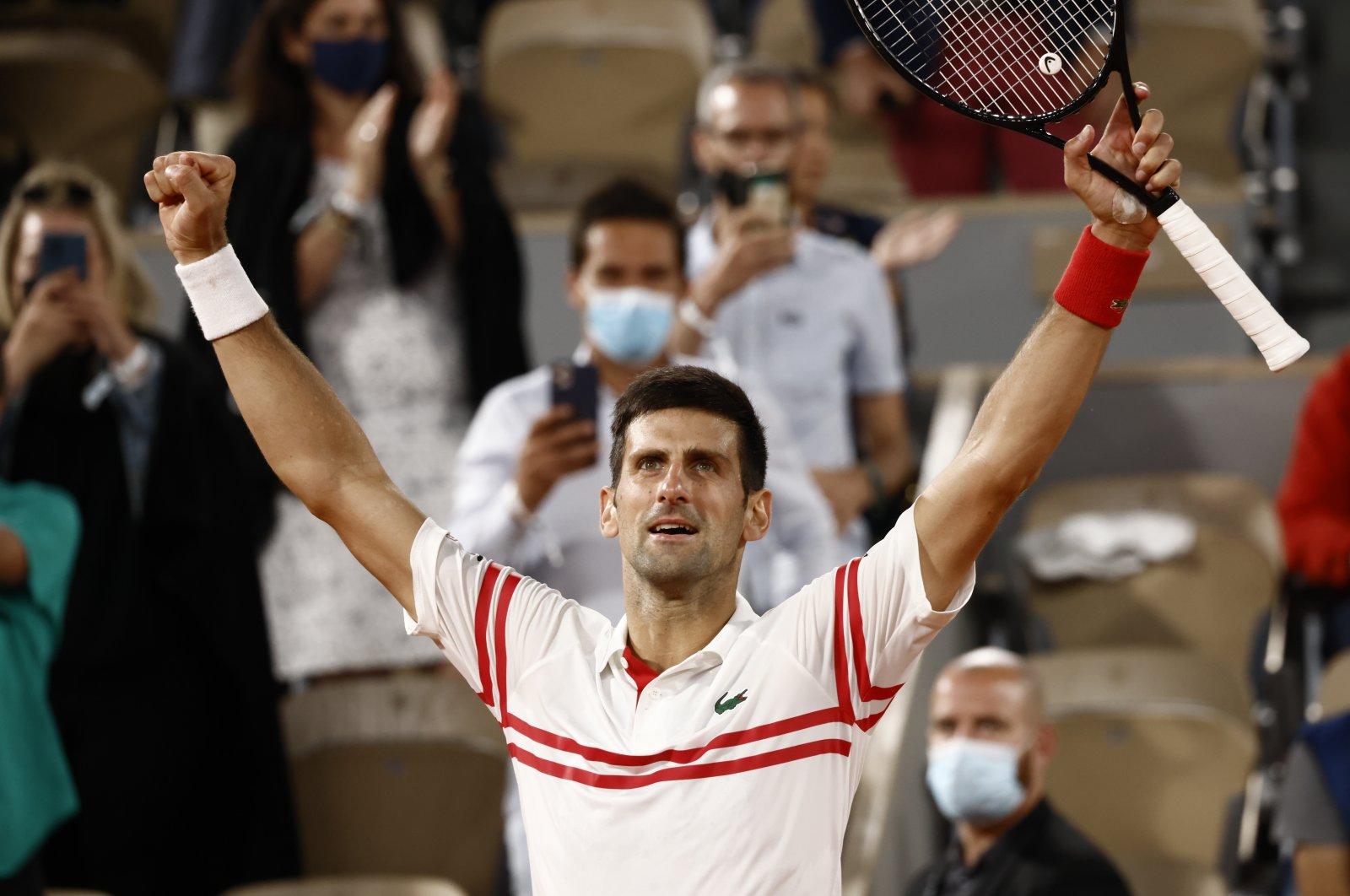 Serbia's Novak Djokovic celebrates winning against Spain's Rafael Nadal during their French Open semifinal match at Roland Garros, Paris, France, June 11, 2021. (EPA Photo)