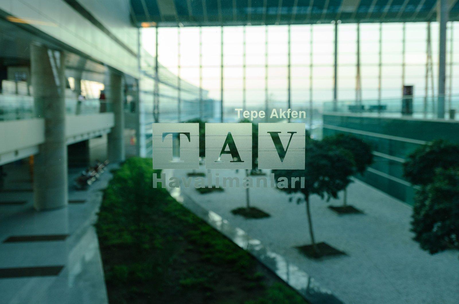 The TAV Airports Holding logo is printed on glass at the Esenboğa International Airport, Ankara, Turkey, Aug. 19, 2017. (Shutterstock Photo)