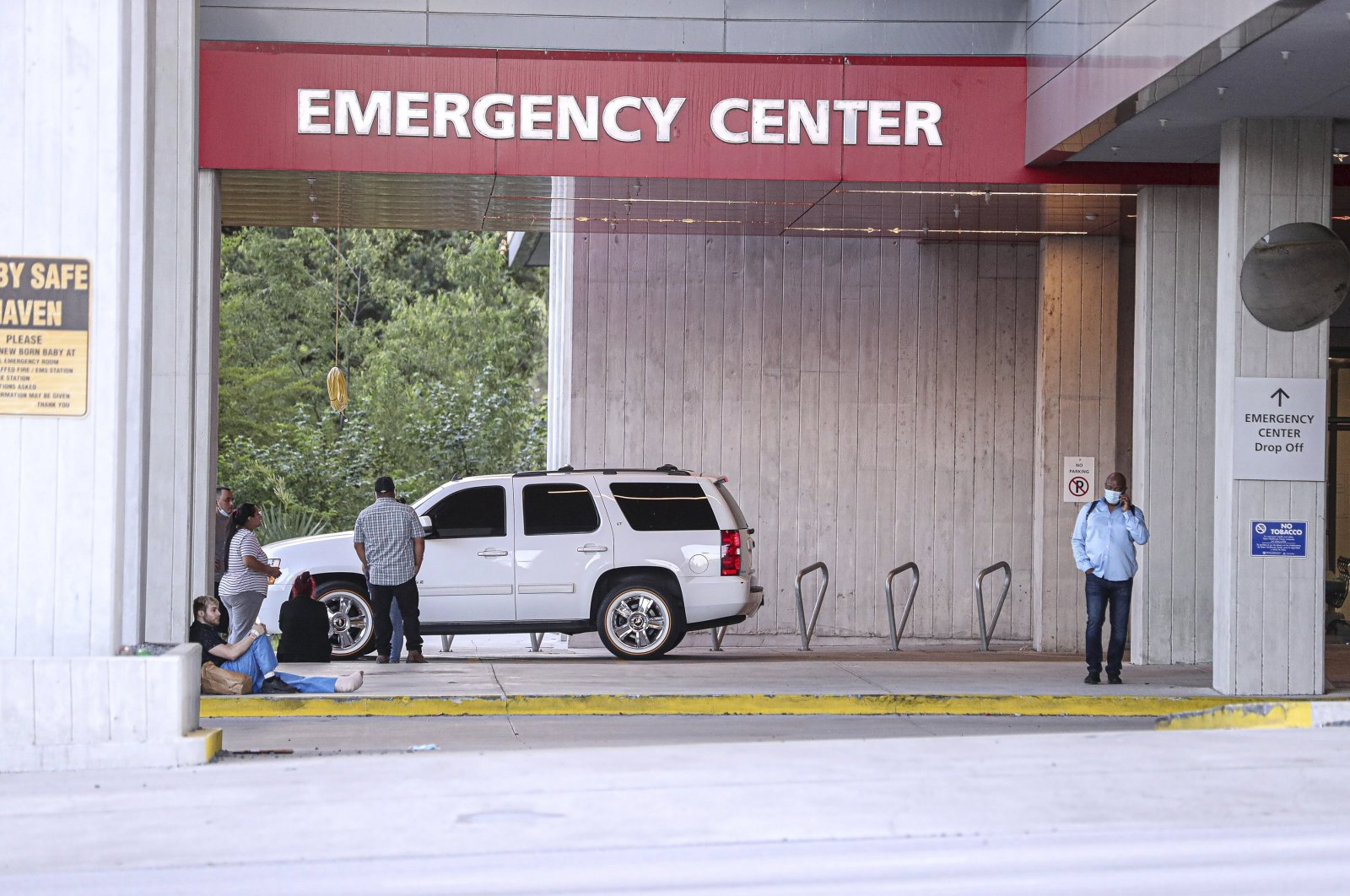 A group of people waits outside Dell Seton Medical Center for news about victims after a shooting in downtown Austin, Texas, U.S., June 12, 2021. (AP Photo)