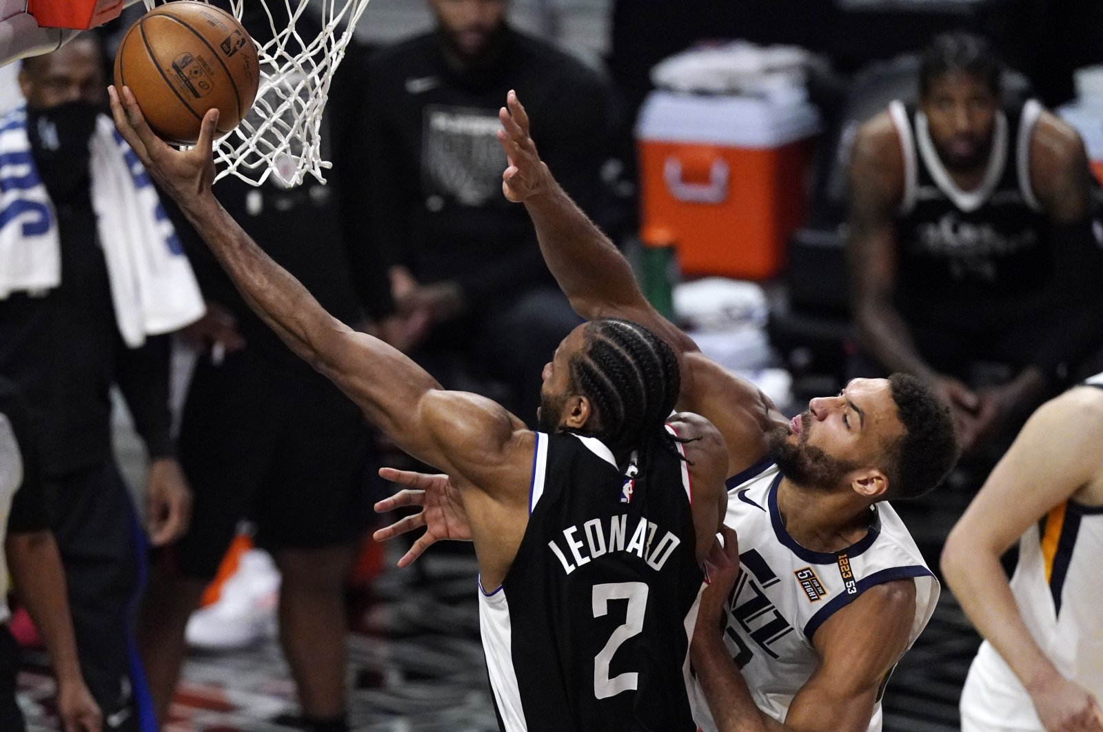 Los Angeles Clippers forward Kawhi Leonard (L) shoots as Utah Jazz center Rudy Gobert defends during the second half of Game 3 of a second-round NBA Playoffs match, Saturday, June 12, 2021, Los Angeles, U.S. (AP Photo)