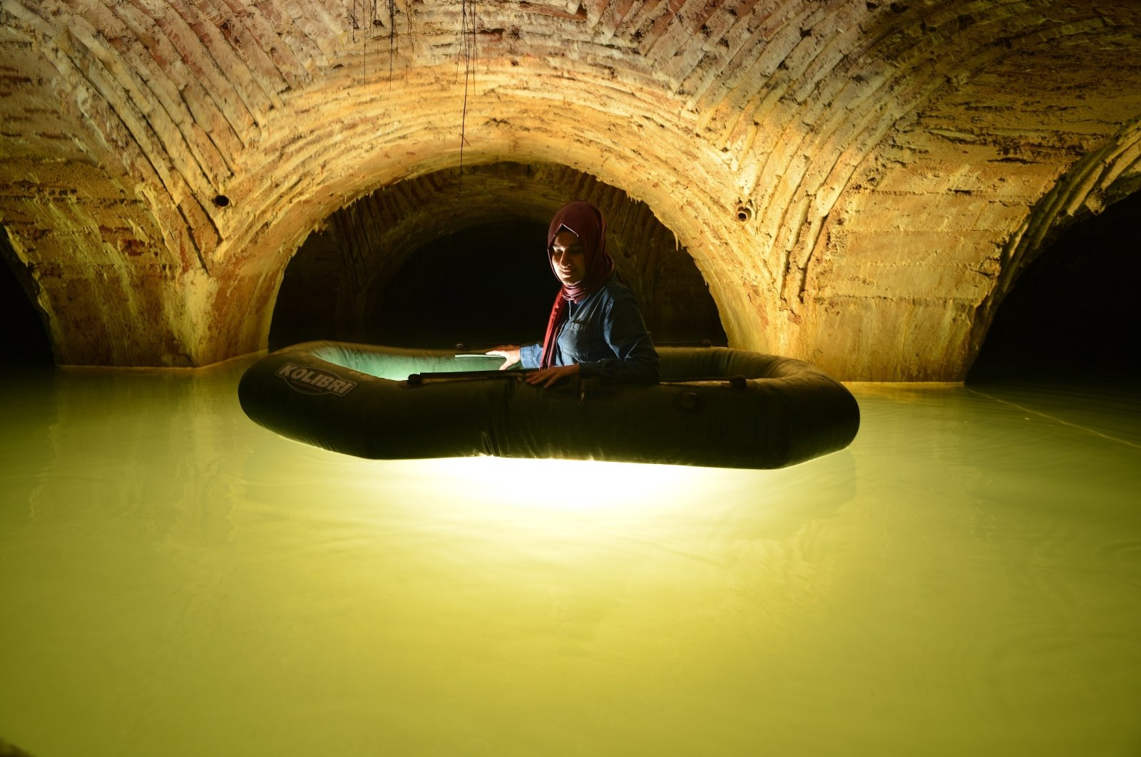 Cultural HeritageConservation Specialist and Historian Arzu Ulaş poses for a photo on a boat on the underground water channels in Istanbul, Turkey, June 13, 2021. (DHA Photo)