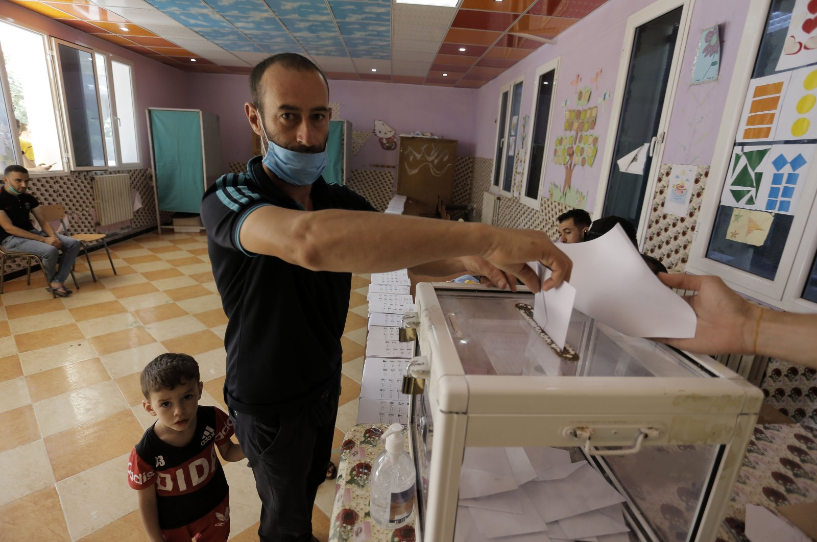 A man casts his vote in a polling station in the country's first legislative elections since the ouster of former President Abdelaziz Bouteflika, in Algiers, Algeria, June 12, 2021. (AP Photo)