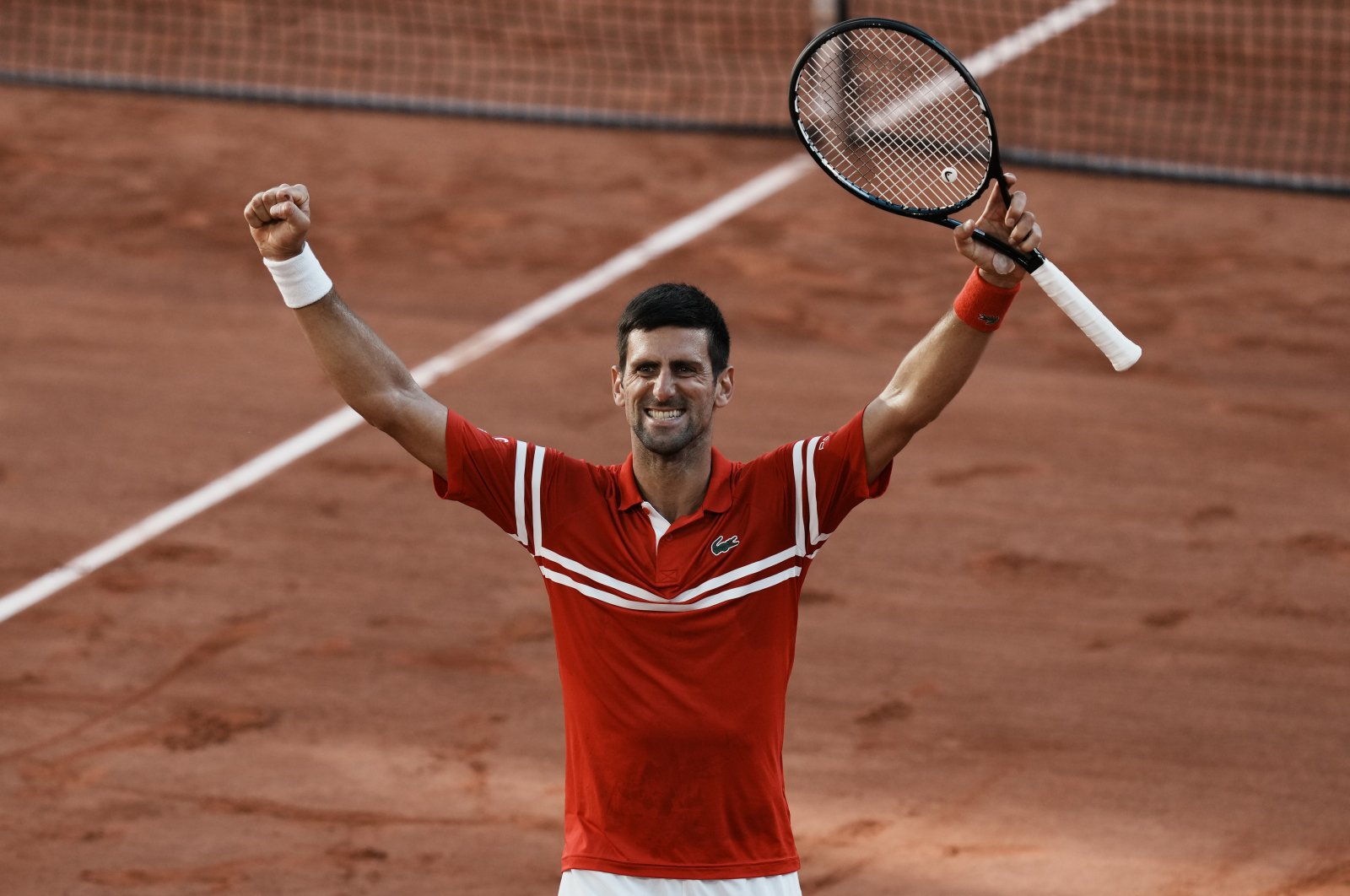 Serbia's Novak Djokovic celebrates after defeating Stefanos Tsitsipas of Greece in the French Open final at the Roland Garros, Paris, France, June 13, 2021. (AP Photo)