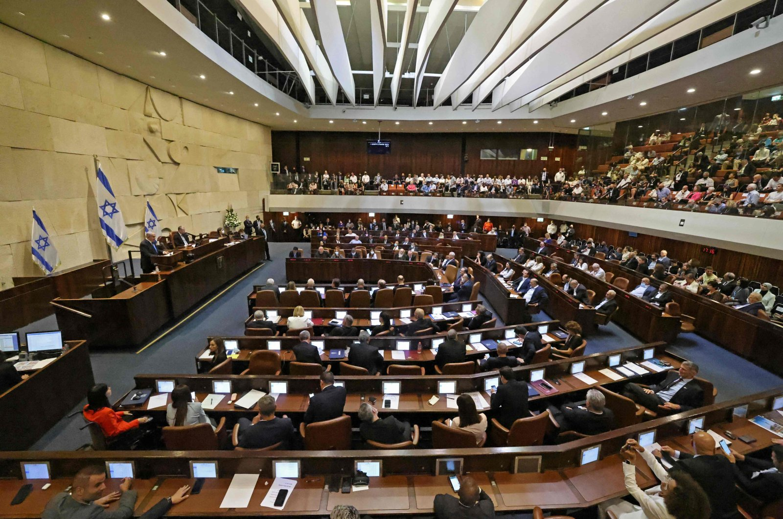Israel's Prime Minister Benjamin Netanyahu addresses lawmakers during a special session to vote on a new government at the Knesset in Jerusalem, June 13, 2021. (AFP Photo)
