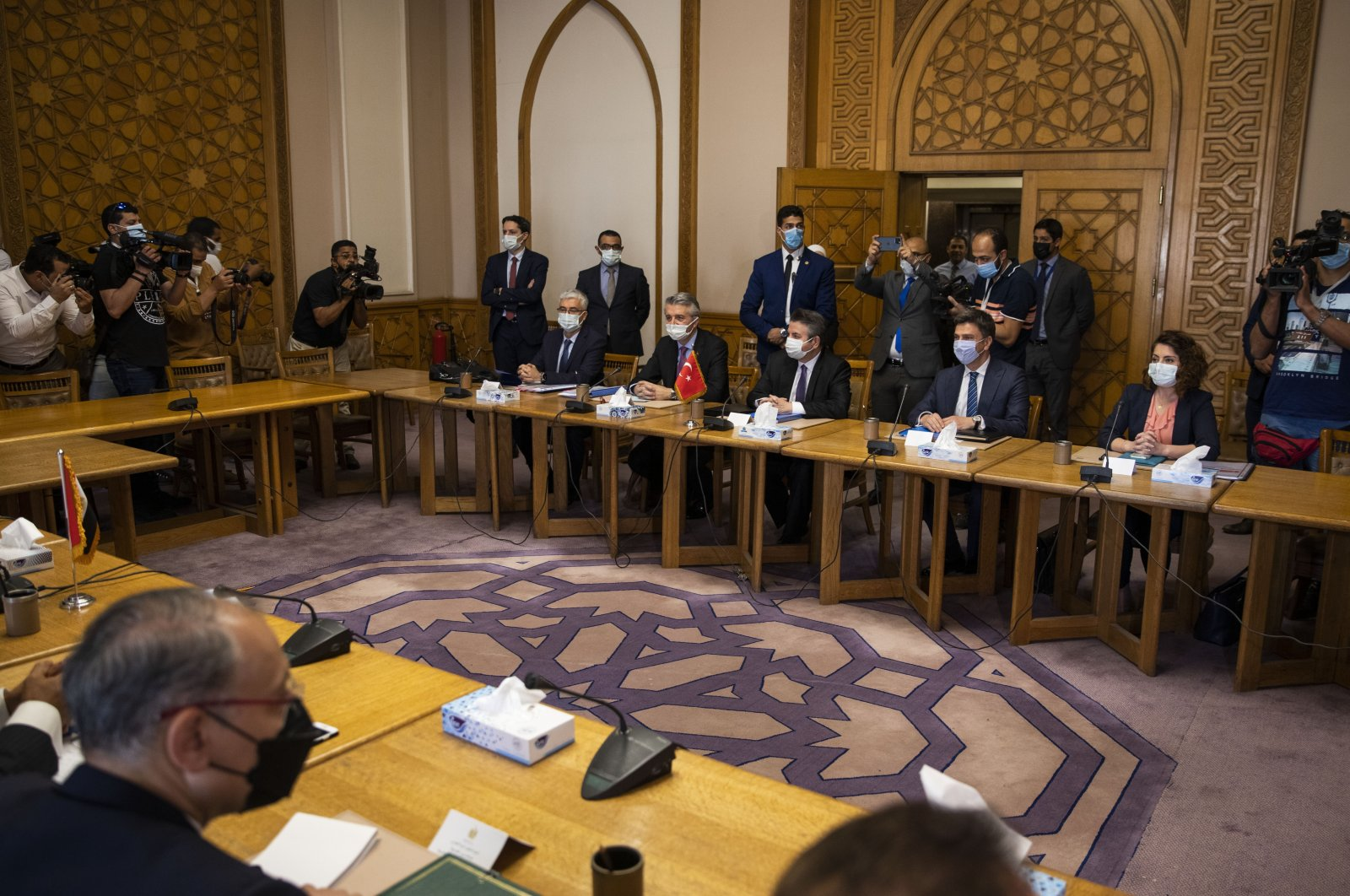 Turkish Foreign Ministry Deputy Sedat Önal, seated third right, meets with Hamdi Sanad Loza, Egyptian deputy foreign minister, and their delegations, at the foreign ministry in Cairo, Egypt, Wednesday, May 5, 2021. (AP File Photo)