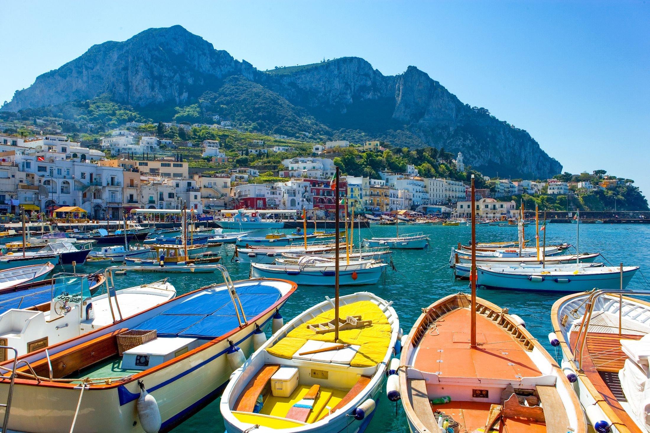 Boats float in harbor of the island of Capri, Italy. (Shutterstock Photo)