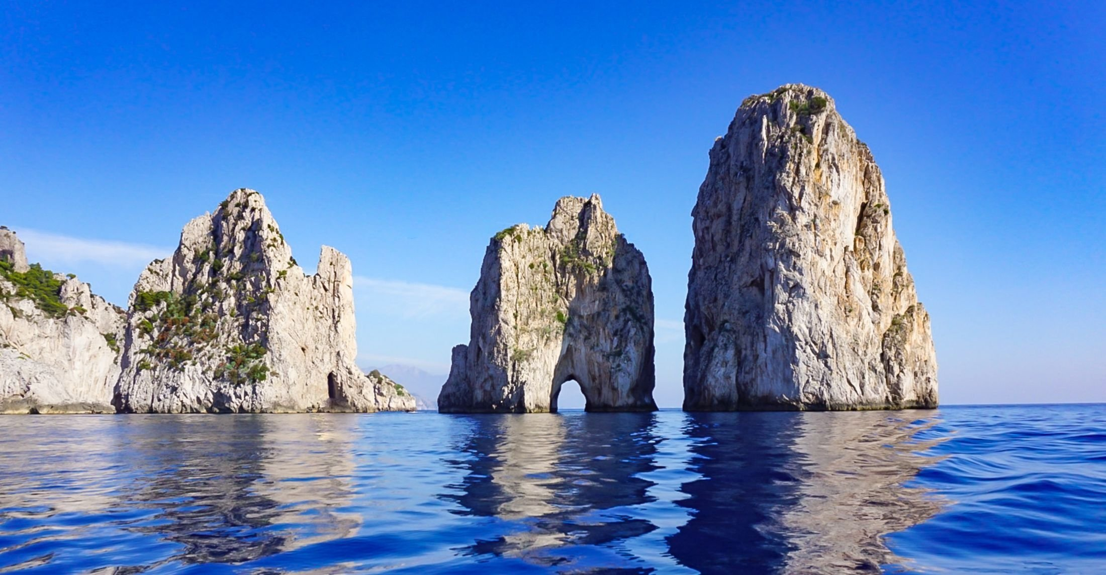 The Faraglioni rocks off the coast of the island of Capri, Italy. (Shutterstock Photo)
