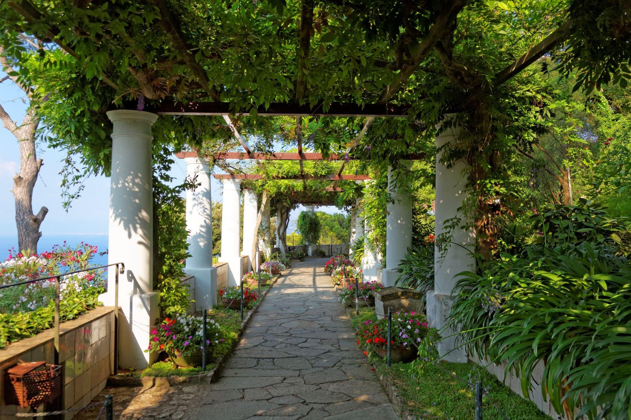 The sun shines through the public gardens of Villa San Michele on the island of Capri, Italy. (Shutterstock Photo)