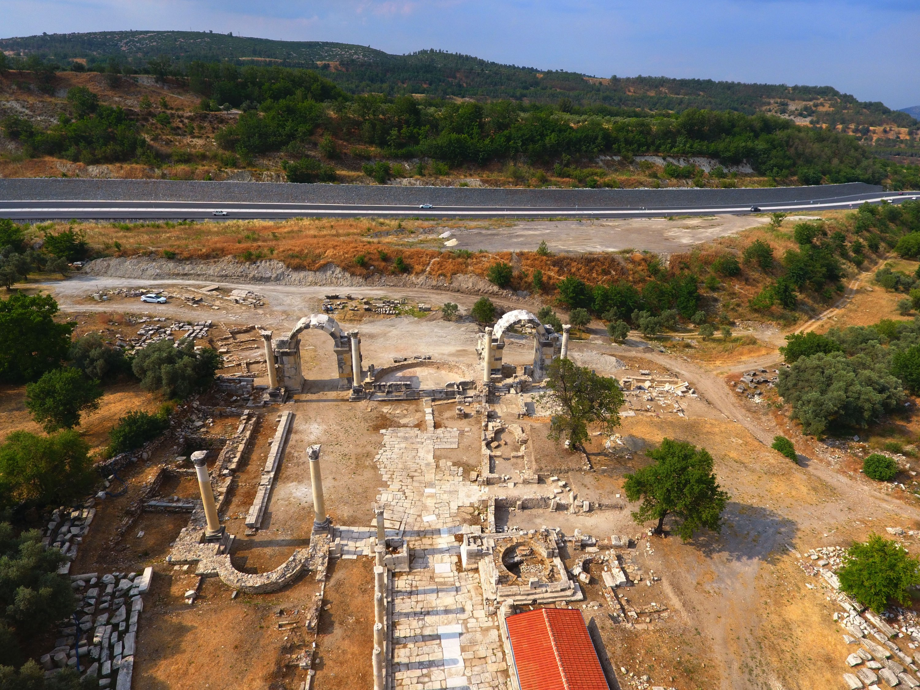 An aerial view shows the recently restorednorthern entrance to the ancient city ofStratonikeia with two arched gates in Muğla, Turkey, June 13, 2021. (AA Photo)