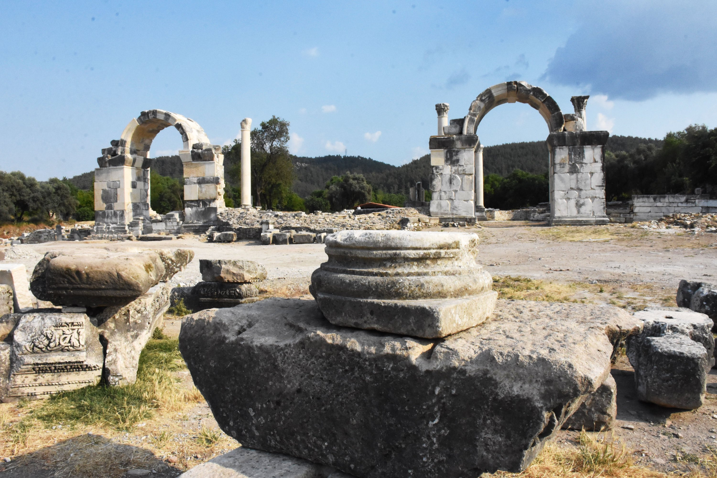 The recently restored northern arched gates ofthe ancient city of Stratonikeia stand in front of a columnaded square in Muğla, Turkey, June 13, 2021. (AA Photo)