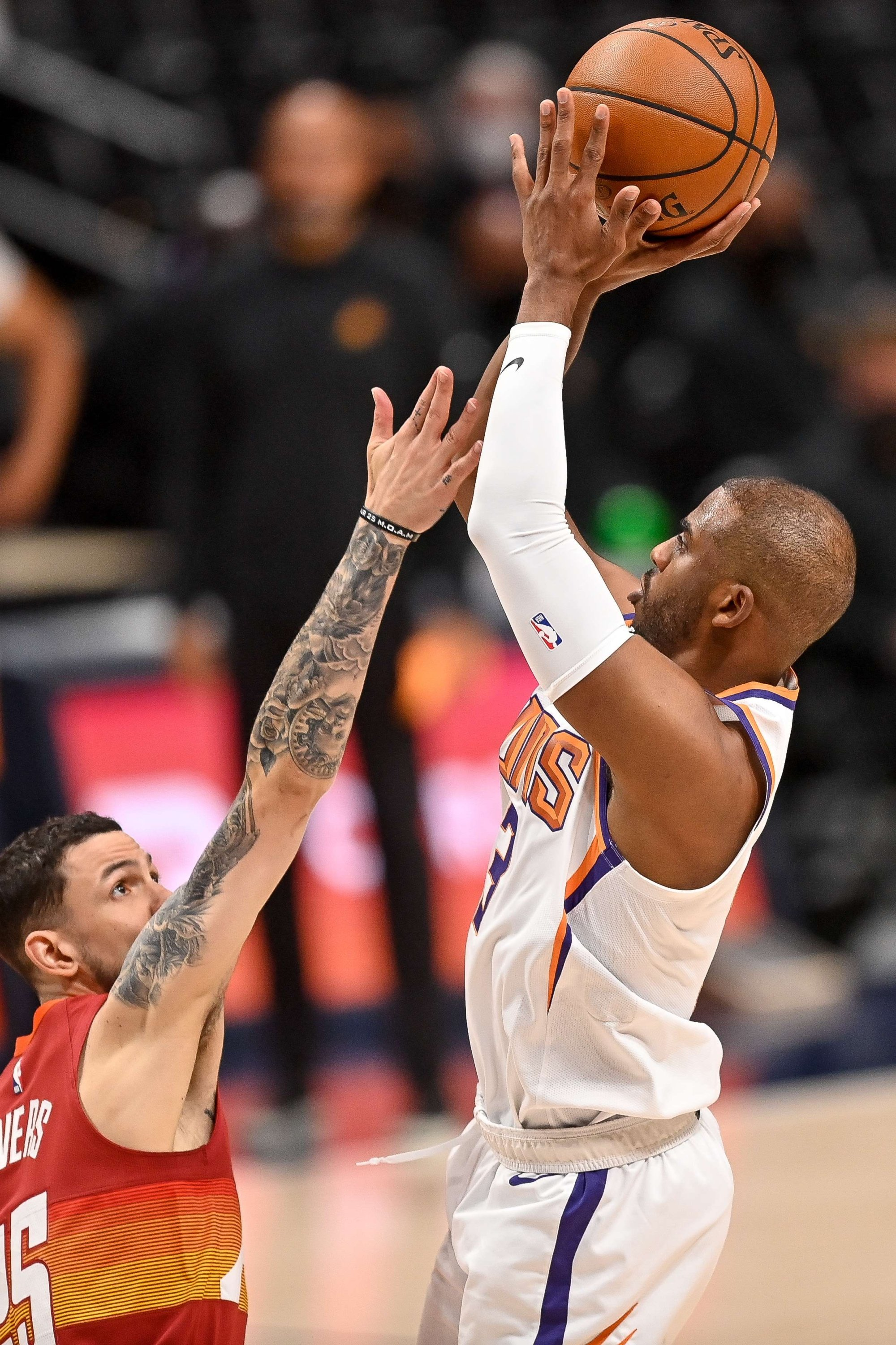 Phoenix Suns' Chris Paul (R) shoots over Denver Nuggets' Austin Rivers (L) in Game 4 of the Western Conference second-round playoff series at Ball Arena Denver, Colorado, U.S., June 13, 2021. (AFP Photo)
