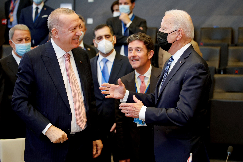 President Tayyip Erdoğan speaks with U.S. President Joe Biden during a plenary session at a NATO summit in Brussels, Belgium, June 14, 2021. (Reuters Photo)
