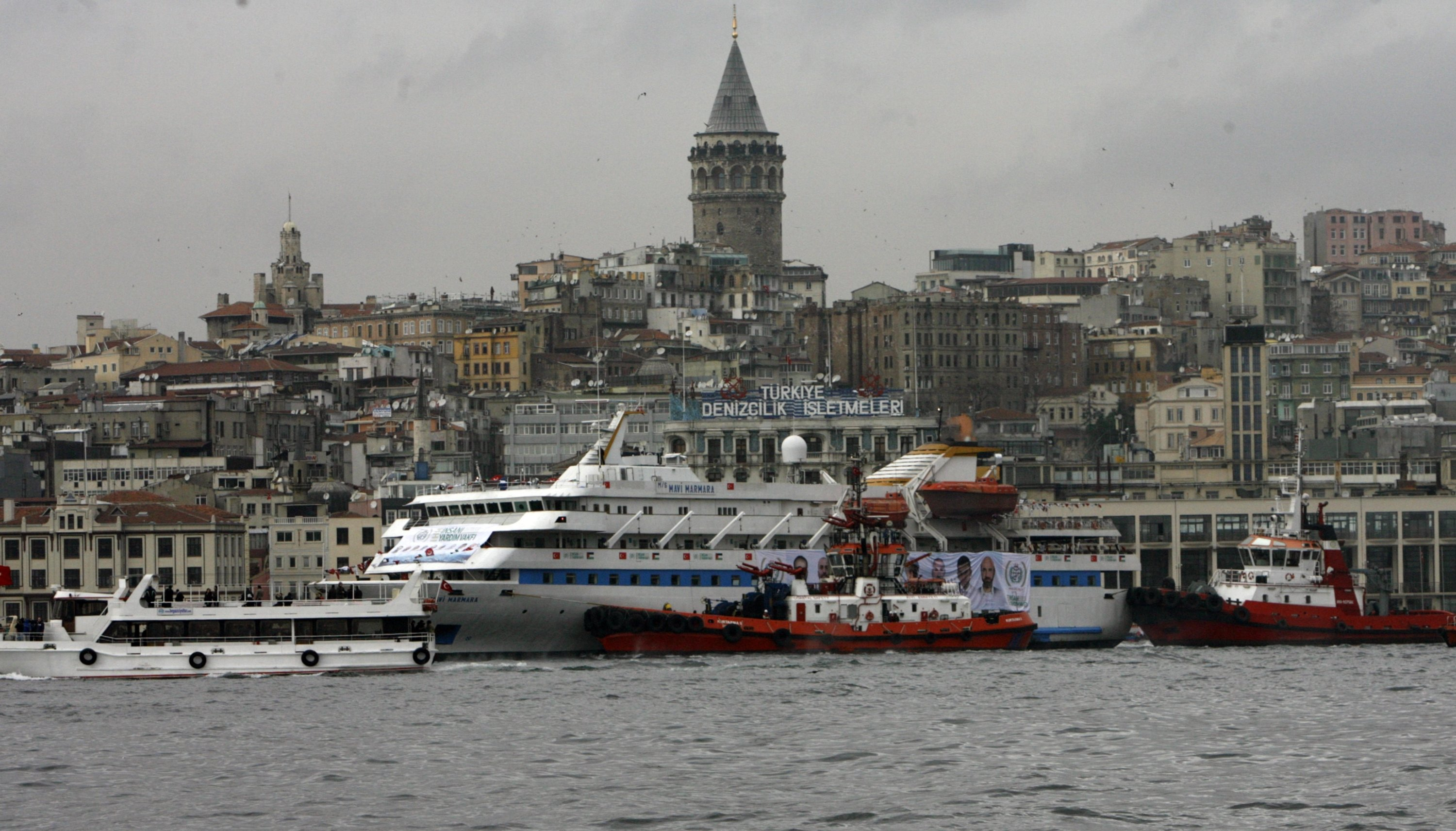 With the historical Galata Tower in the background, the Mavi Marmara – the lead boat of a flotilla headed to the Gaza Strip that was stormed by Israeli naval commandos in a predawn confrontation in the Mediterranean on May 31, 2010 – returns in Istanbul, Turkey, Dec. 26, 2010. (AP Photo)