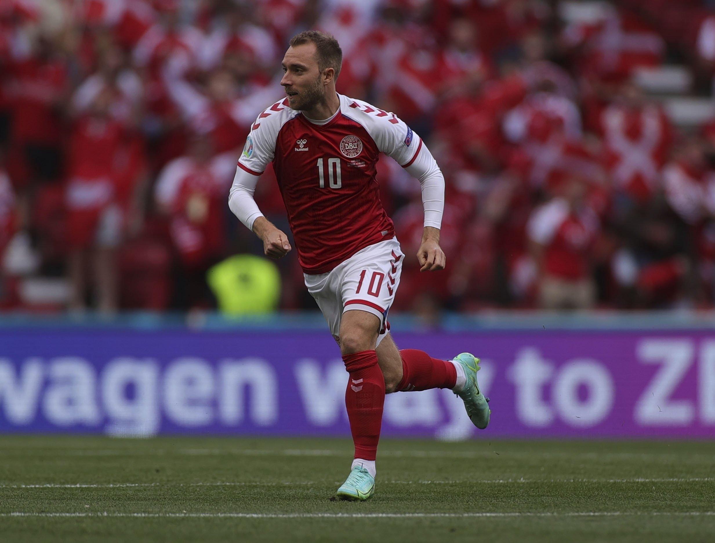 Denmark's Christian Eriksen runs during the Euro 2020 Group B match against Finland at Parken stadium, Copenhagen, Denmark, June 12, 2021. (AP Photo)