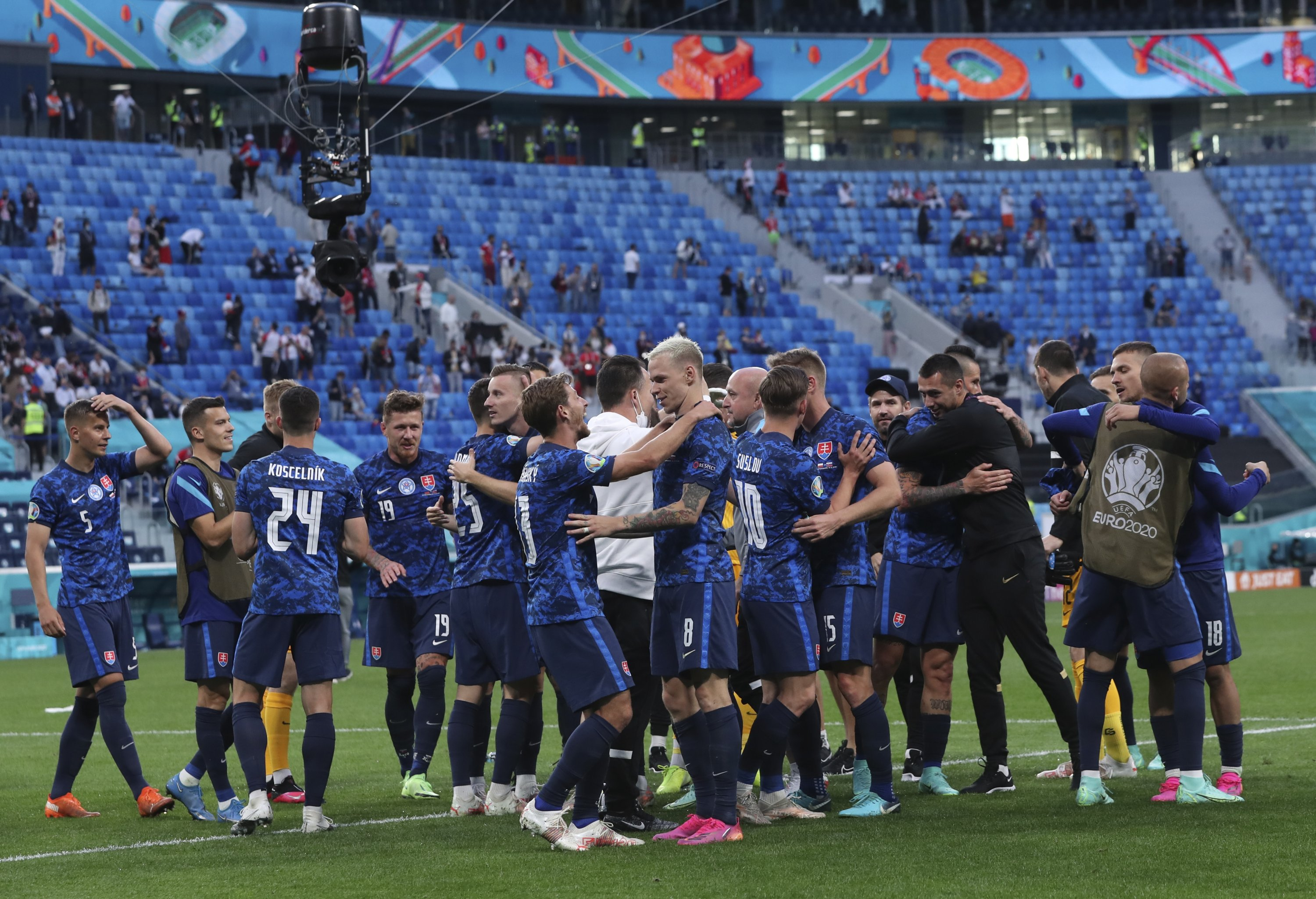 Slovakian players celebrate at the end of the UEFA Euro 2020 Group E match against Poland at Gazprom Arena Stadium in St. Petersburg, Russia, Monday, June 14, 2021. (Evgenya Novozheninavia AP)