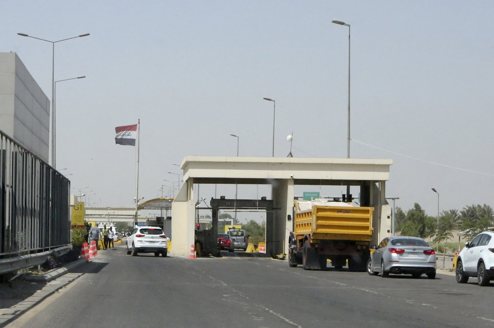 Traffic backs up at the entrance to the Baghdad International Airport, one day after a booby-trapped drone struck the airport area, in the capital Baghdad, Iraq, June 10, 2021. (AFP Photo)