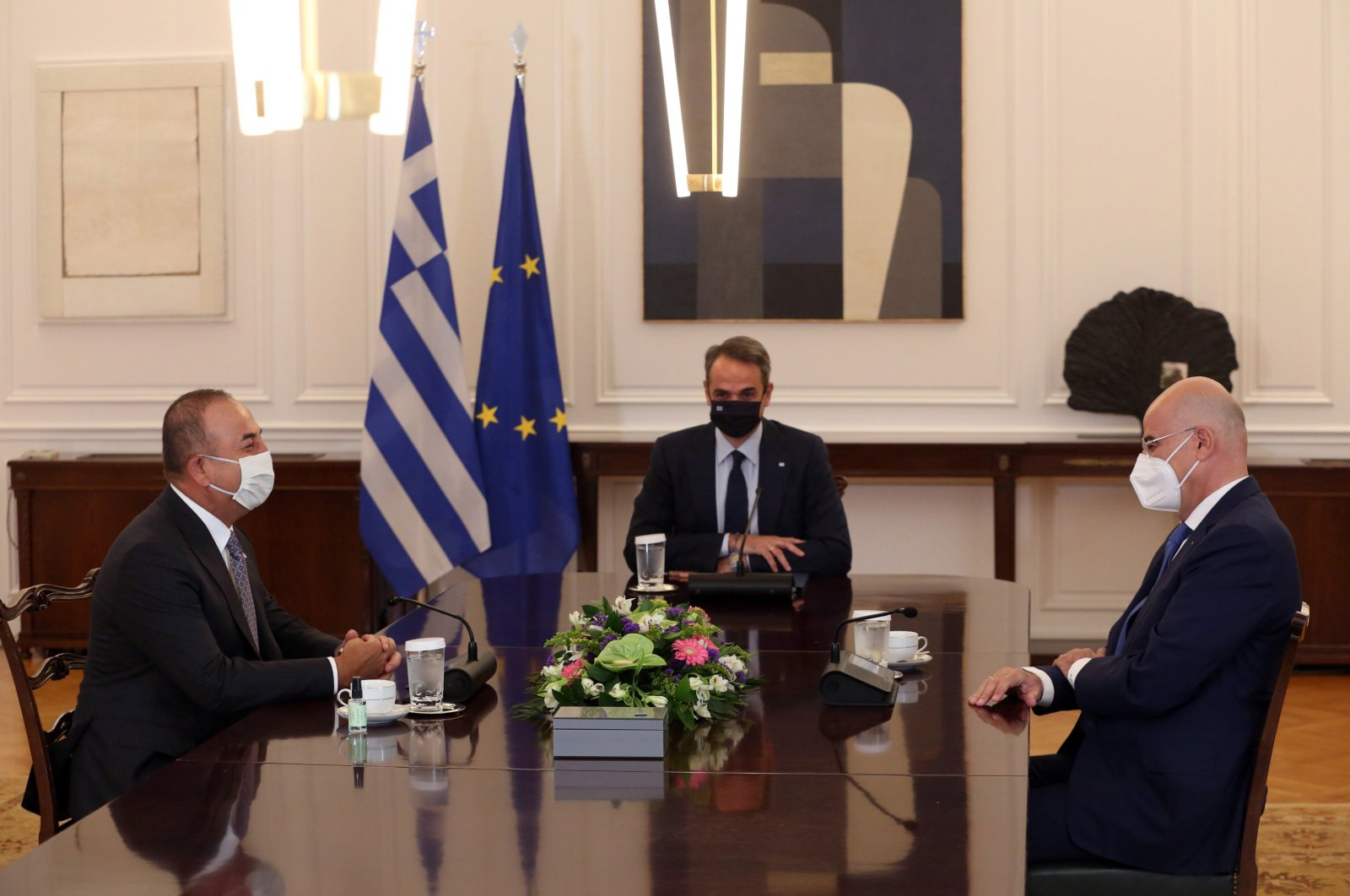 Greek Prime Minister Kyriakos Mitsotakis (C) meets with Turkish Foreign Minister Mevlut Cavusoglu (L) in the presence of Greek Foreign Minister Nikos Dendias at Maximos Mansion in Athens, Greece, May 31, 2021. (EPA Photo)