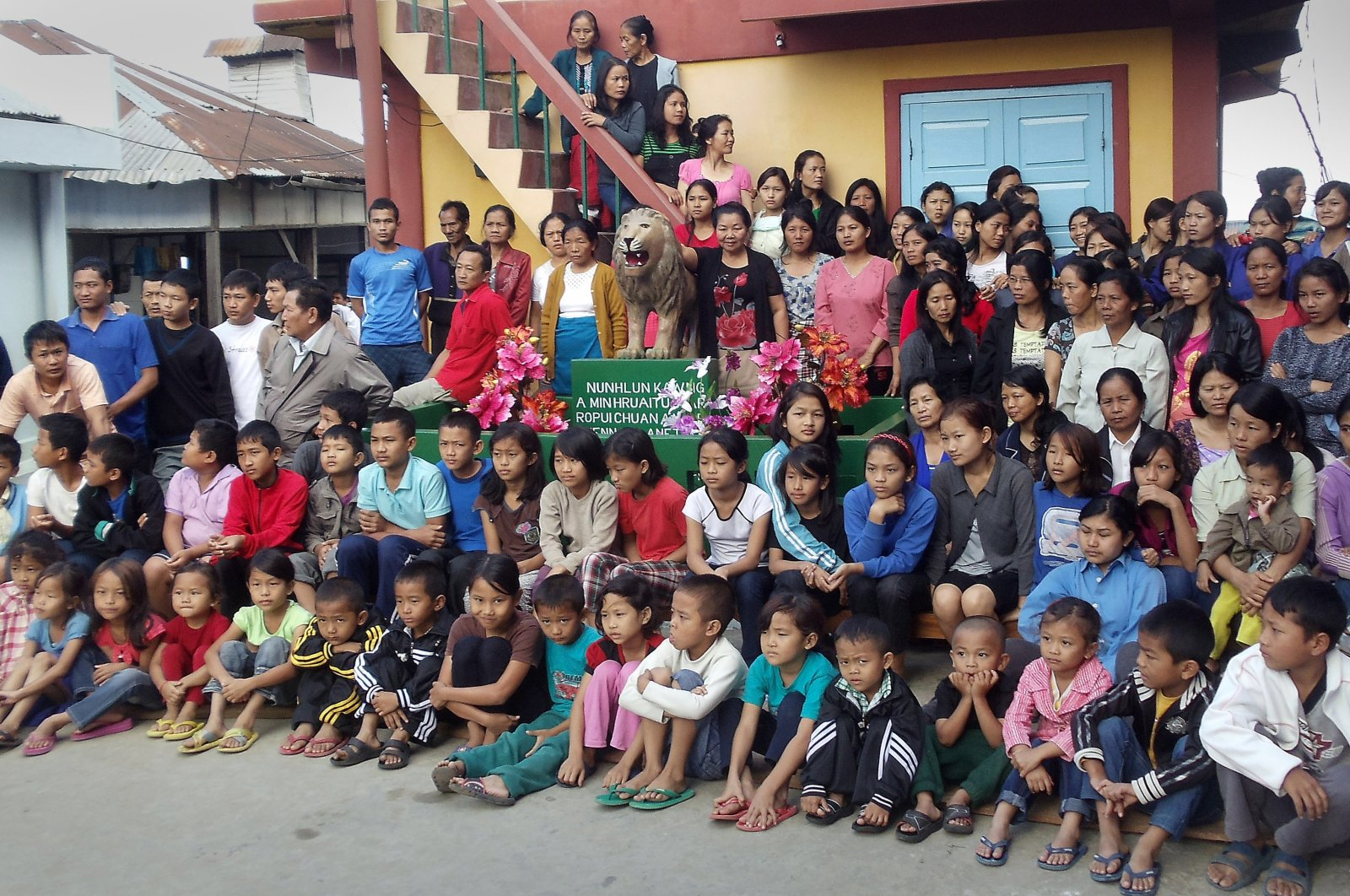Members of the Chana family pose for a photograph at their home in the village of Baktawng in the Serchhip district, located about 70 kilometers (44 miles) from Mizoram state's capital city Aizawl, northeast India, Oct. 28, 2011. (EFA-EPA Photo)