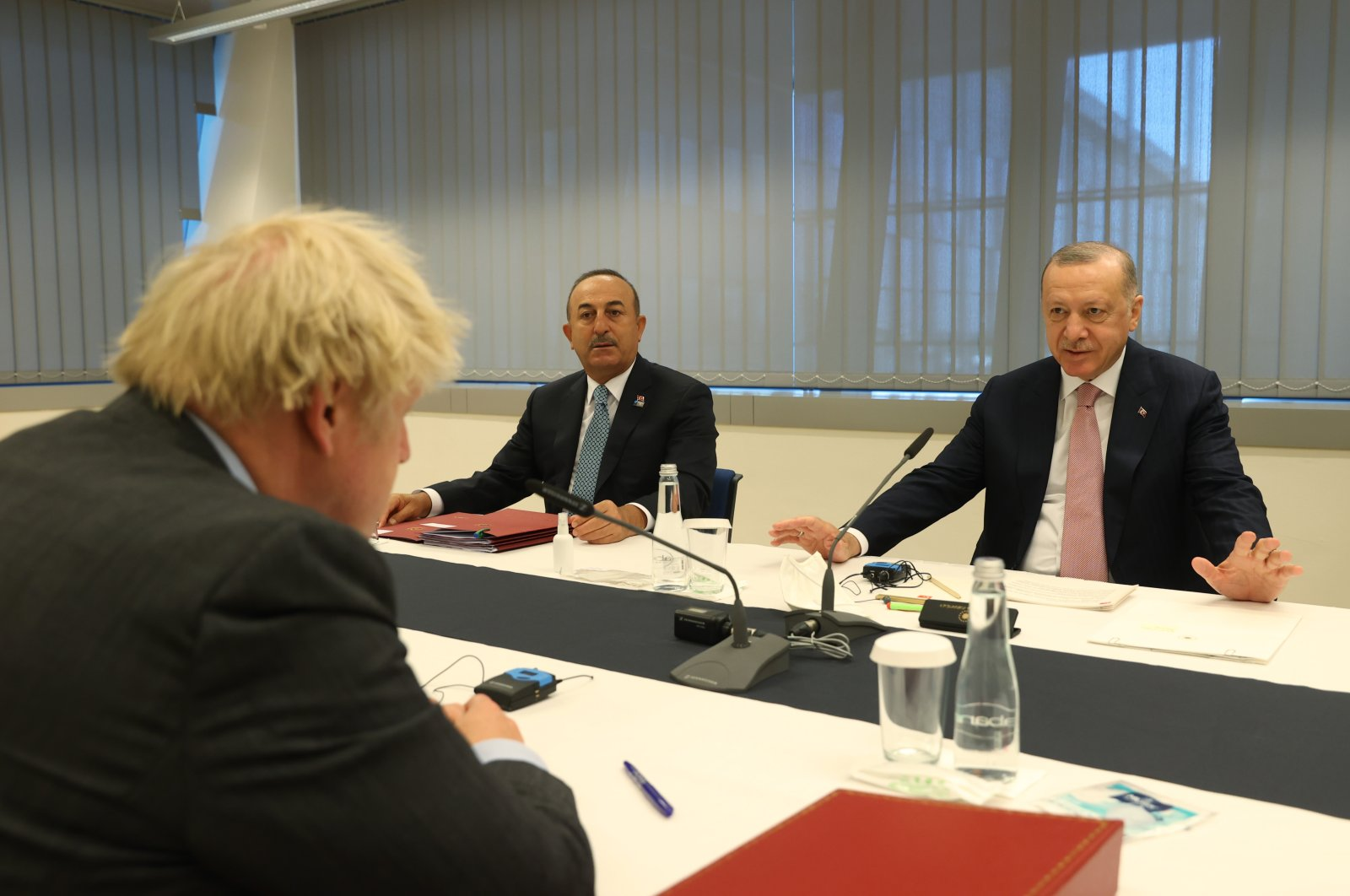 President Recep Tayyip Erdoğan (R), Foreign Minister Mevlüt Çavuşoğlu and British Prime Minister Boris Johnson meeton the sidelines of the NATO summit in Brussels, Belgium, June 14, 2021. (AA Photo)