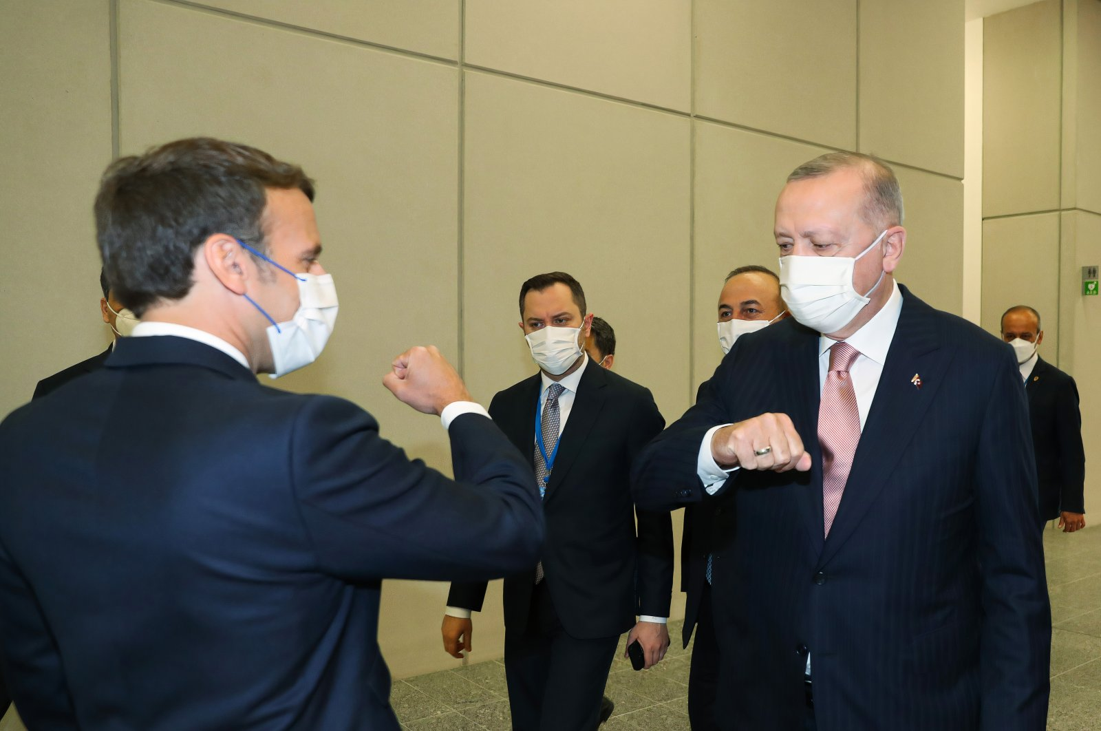President Recep Tayyip Erdoğan and French President Emmanuel Macron gesture at the NATO summit in Brussels, Belgium, June 14, 2021. (IHA Photo)