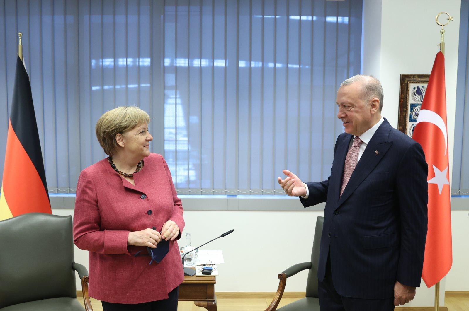 President Recep Tayyip Erdoğan and German Chancellor Angela Merkel gesture at the NATO summit in Brussels, Belgium, June 14, 2021. (AA Photo)