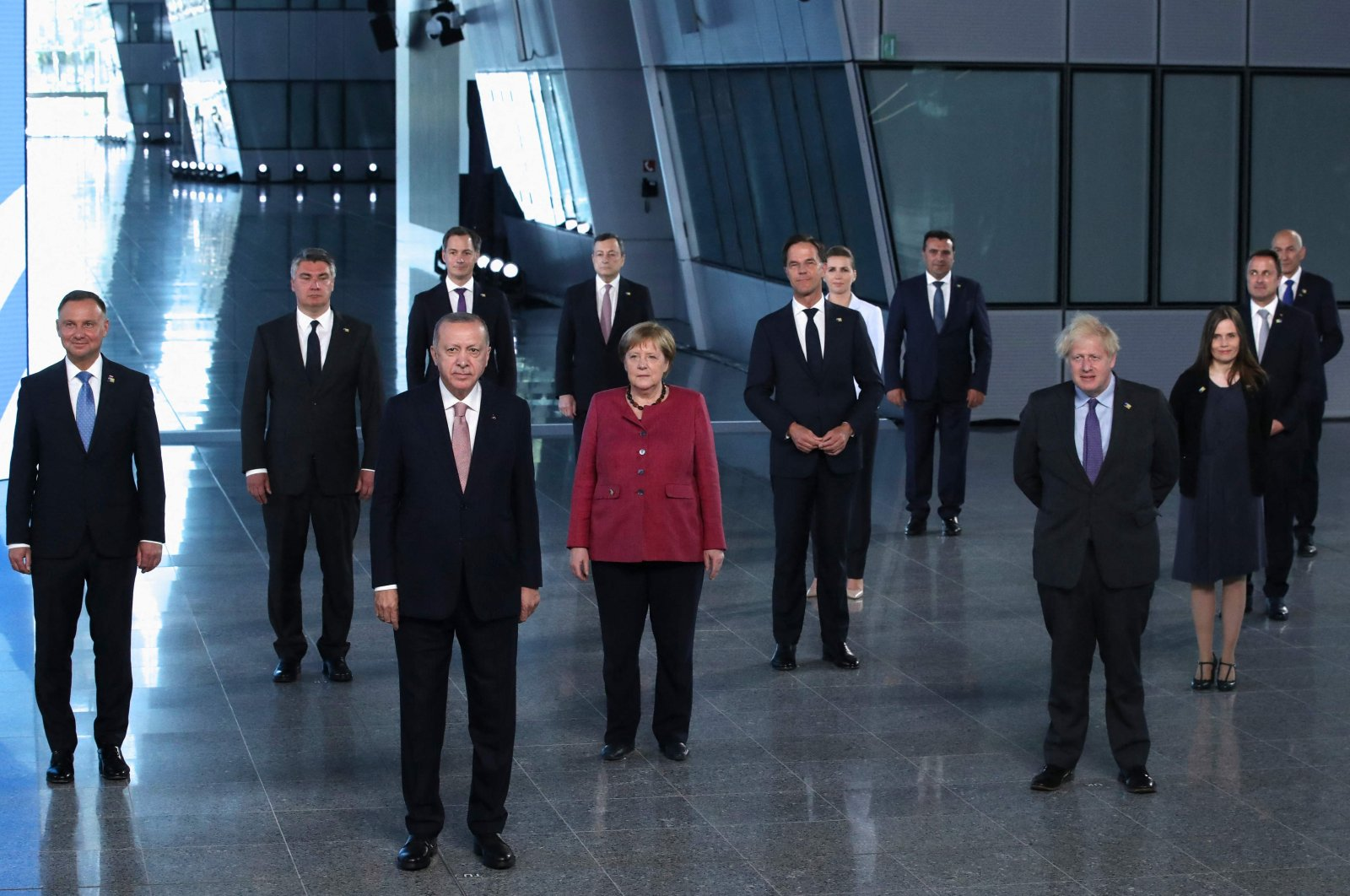 President Recep Tayyip Erdoğan (3rd L) looks on next to German Chancellor Angela Merkel (C) and Britain's Prime Minister Boris Johnson (R) as NATO heads of the states and governments pose for a photo prior to a NATO summit at the North Atlantic Treaty Organization (NATO) headquarters in Brussels, June 14, 2021. (AFP Photo)