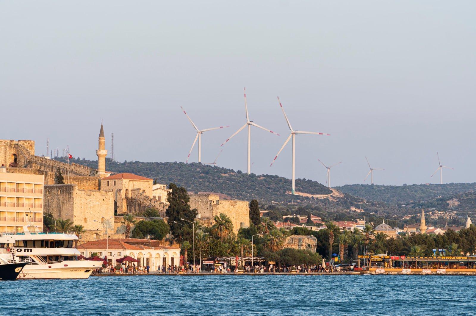 Windmills dot the skyline above the Çeşme coastline, İzmir, western Turkey, July 31, 2019. (Shutterstock Photo)