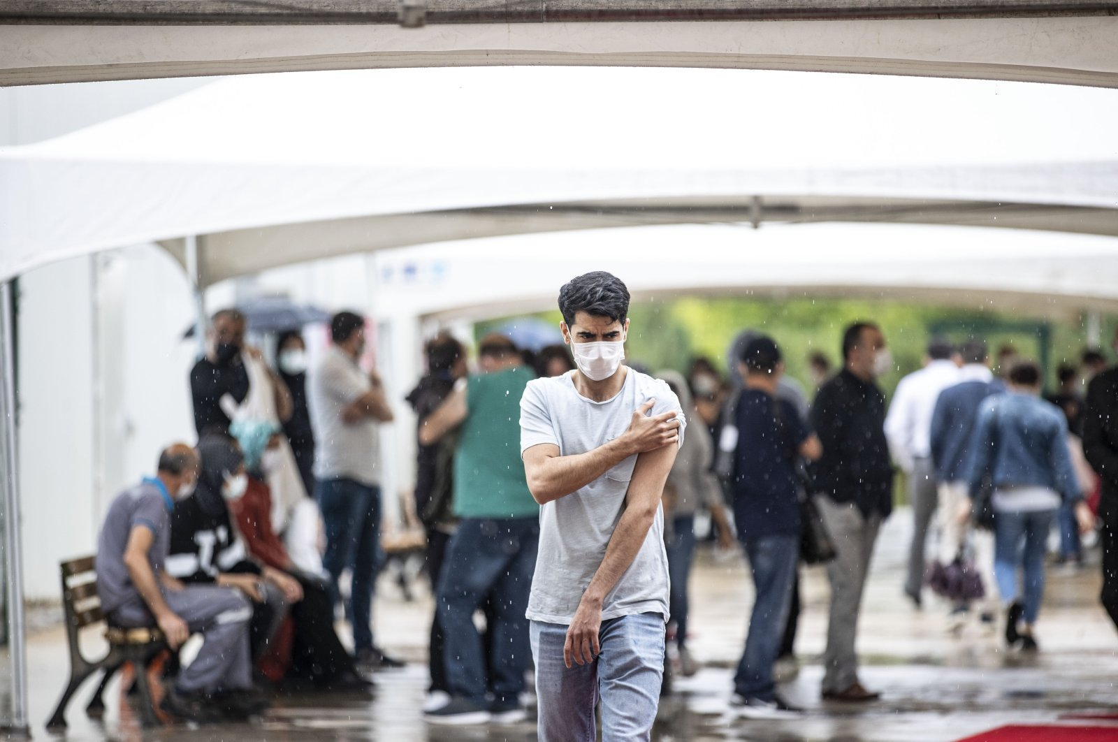 A man holds his upper arm after leaving a vaccination point at a hospital, in Istanbul, Turkey, June 14, 2021. (AA PHOTO)