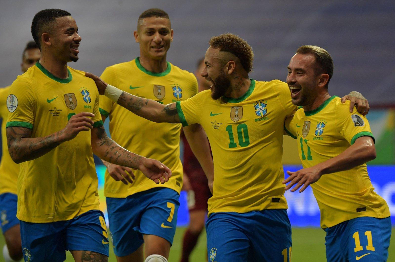 Brazil's Neymar (2nd R) celebrates with teammates after scoring against Venezuela during the CONMEBOL Copa America 2021 football tournament group phase match at the Mane Garrincha Stadium, Brasilia, Brazil, June 13, 2021. (AFP Photo)