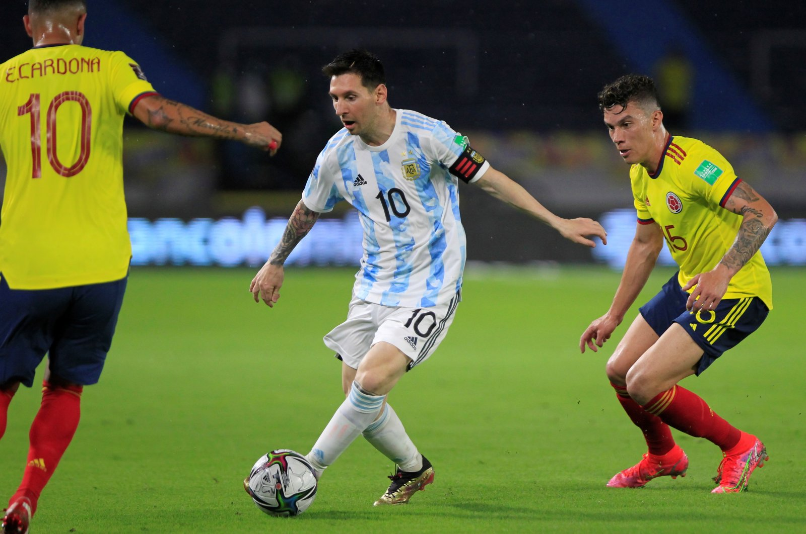 Argentina's Lionel Messi (C) in action against Mateus Uribe (R) of Colombia during a South American World Cup Qualifiers match, at the Metropolitano Stadium, Barranquilla, Colombia, June 8, 2021. (EPA Photo)