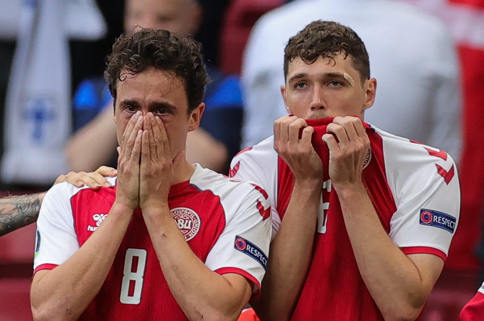 Denmark's midfielder Thomas Delaney and defender Andreas Christensen react as paramedics attend to Denmark's midfielder Christian Eriksen after he collapsed on the pitch during the UEFA EURO 2020 Group B match against Finland at the Parken Stadium, Copenhagen, Denmark, June 12, 2021. (AFP Photo)