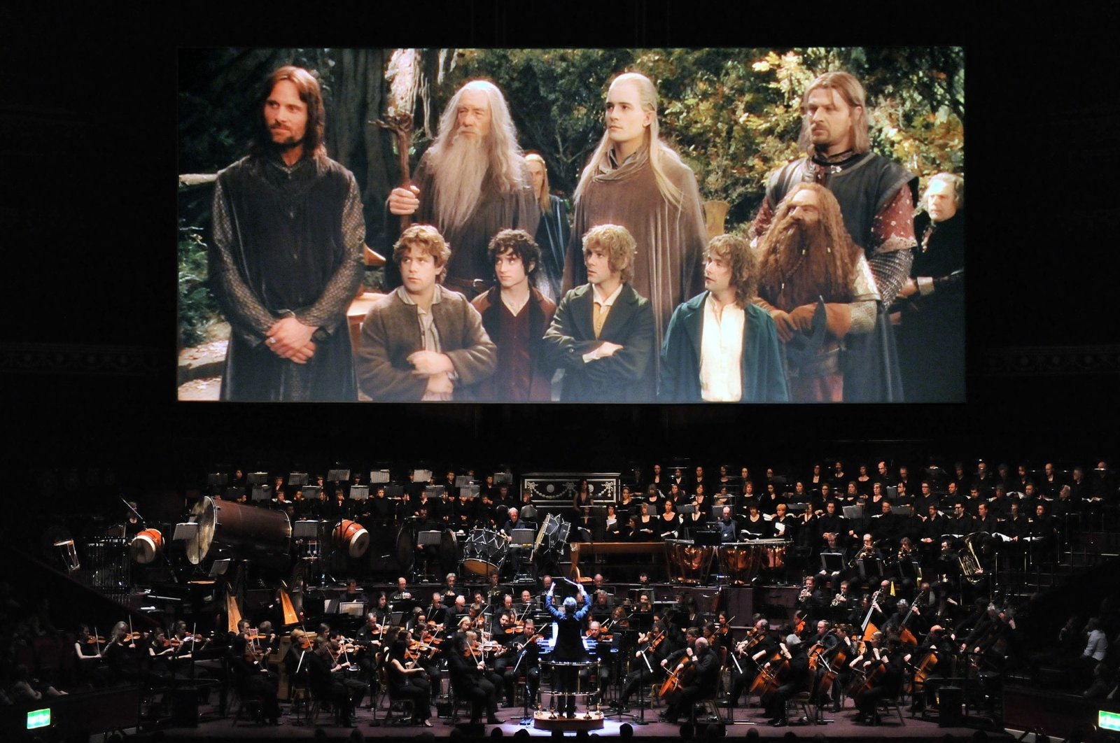 """Academy Award-winning composer Howard Shore conducts a """"The Lord of the Rings"""" symphony orchestra during a live event. (Archive Photo)"""