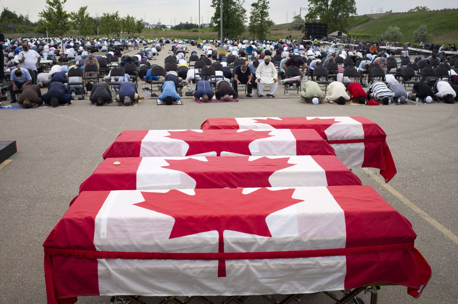 Mourners and supporters gather for a public funeral for members of the Afzaal family at the Islamic Centre of Southwest Ontario in London, Canada, June 12, 2021. (AFP Photo)