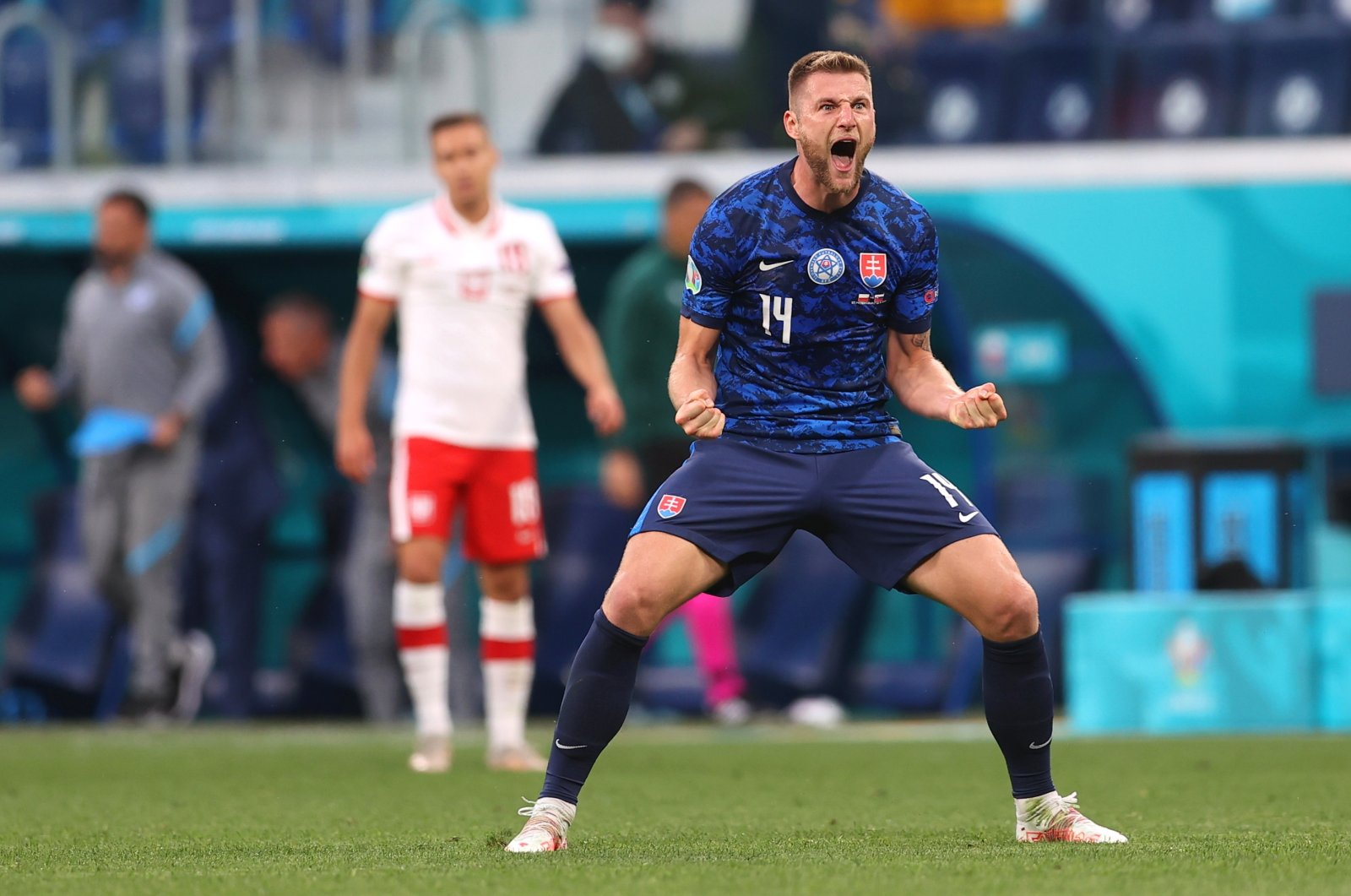 Milan Skriniar of Slovakia celebrates his team's second goal after the UEFA Euro 2020 group E preliminary round soccer match between Poland and Slovakia at Gazprom Arena Stadium in St. Petersburg, Russia, June 14, 2021. (EPA / Lars Baron)