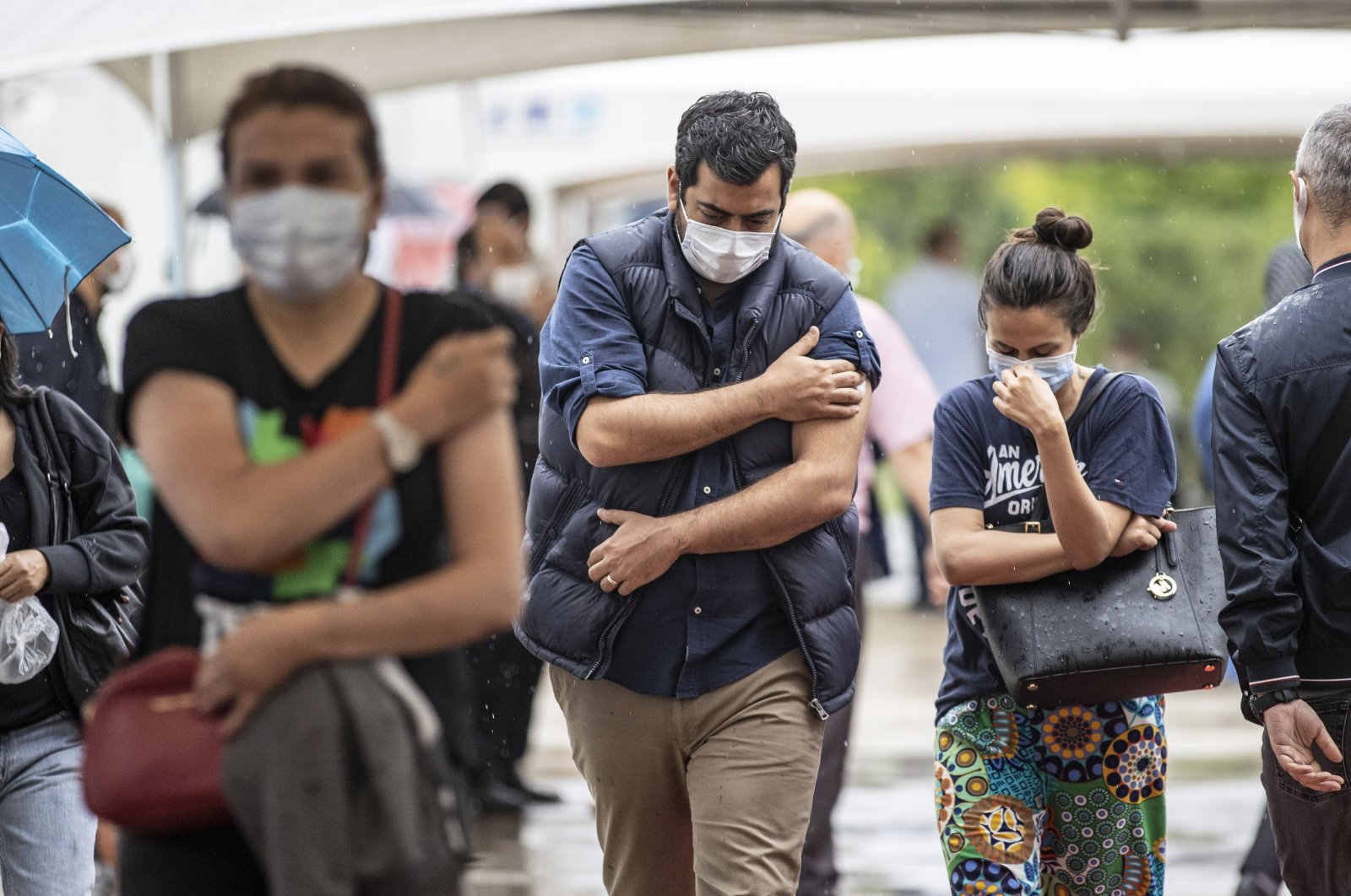 Citizens leave the Professor Dr. Feriha Öz Emergency Hospital in Istanbul after receiving their COVID-19 vaccines, Istanbul, Turkey, June 14, 2021. (AA Photo)