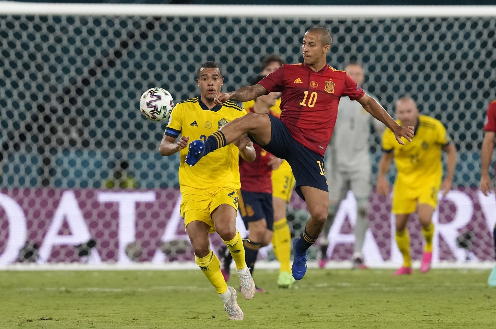 Sweden's Kristoffer Olsson (L) challenges Spain's Thiago for the ball during the Euro 2020 Group E match at La Cartuja stadium in Seville, Spain, June 14, 2021. (AP Photo)