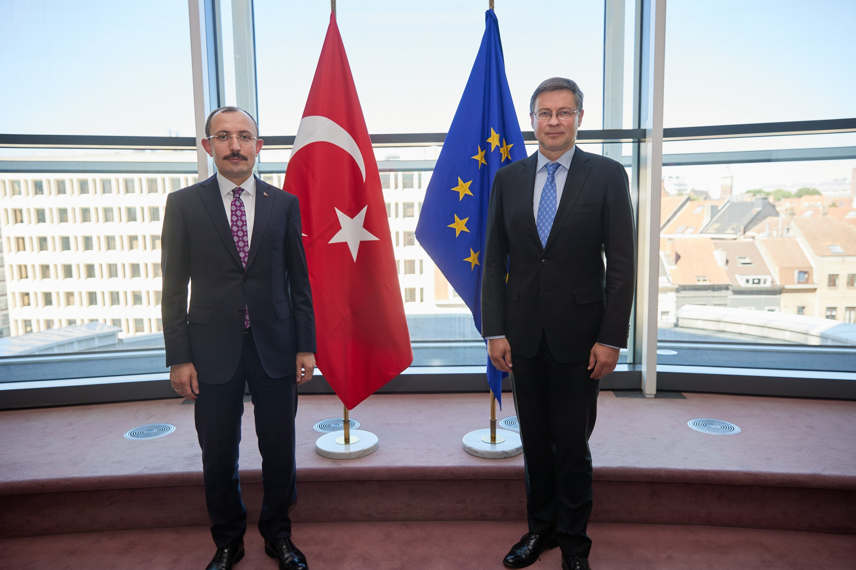Trade Minister Mehmet Muş (L) meets with the EU's trade commissioner and European Commission vice president, Valdis Dombrovskis, in Brussels, Belgium, June 14, 2021. (European Comission via AA)
