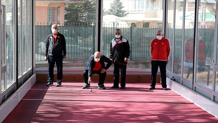 Residents of a care home for the elderly play bocce, in Sivas, central Turkey, Feb. 10, 2021. (AA PHOTO)